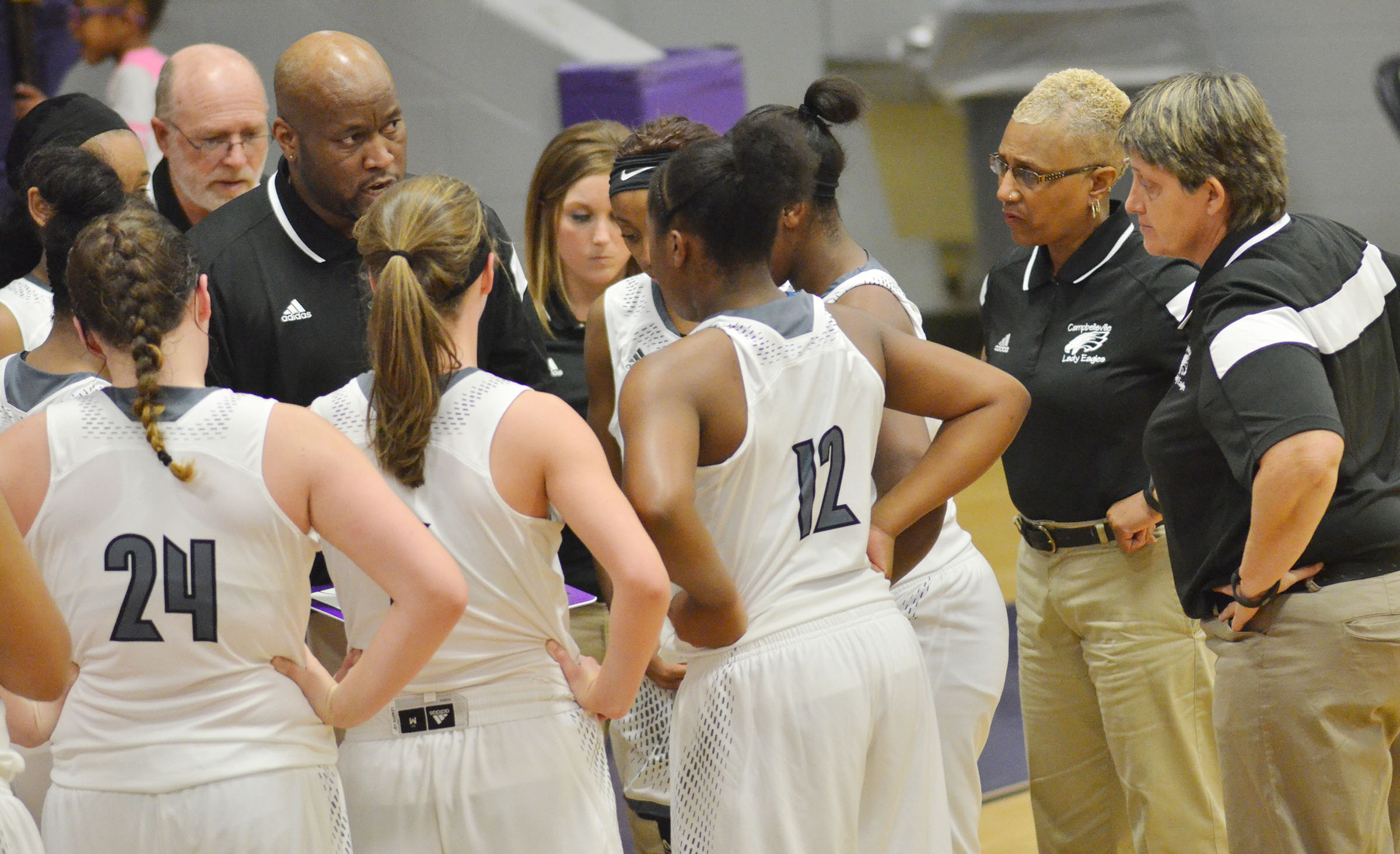 CHS girls' basketball coaches talk to their players.