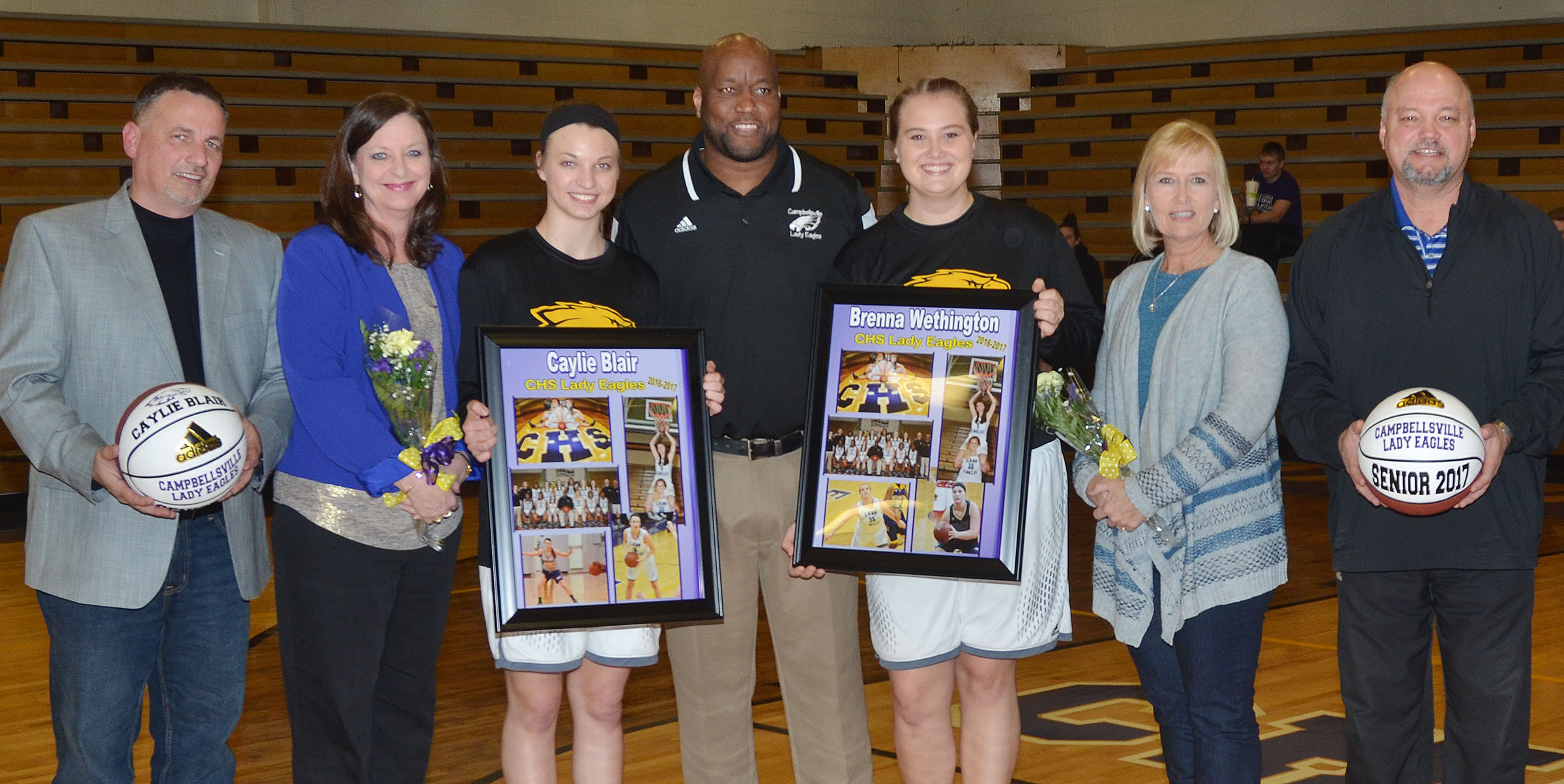 CHS girls' basketball senior players Caylie Blair and Brenna Wethington are honored. From left are Caylie's parents Bryan Blair and Terri Slinker, Caylie, head coach Anthony Epps, Brenna and her parents, Sheila and John Wethington.