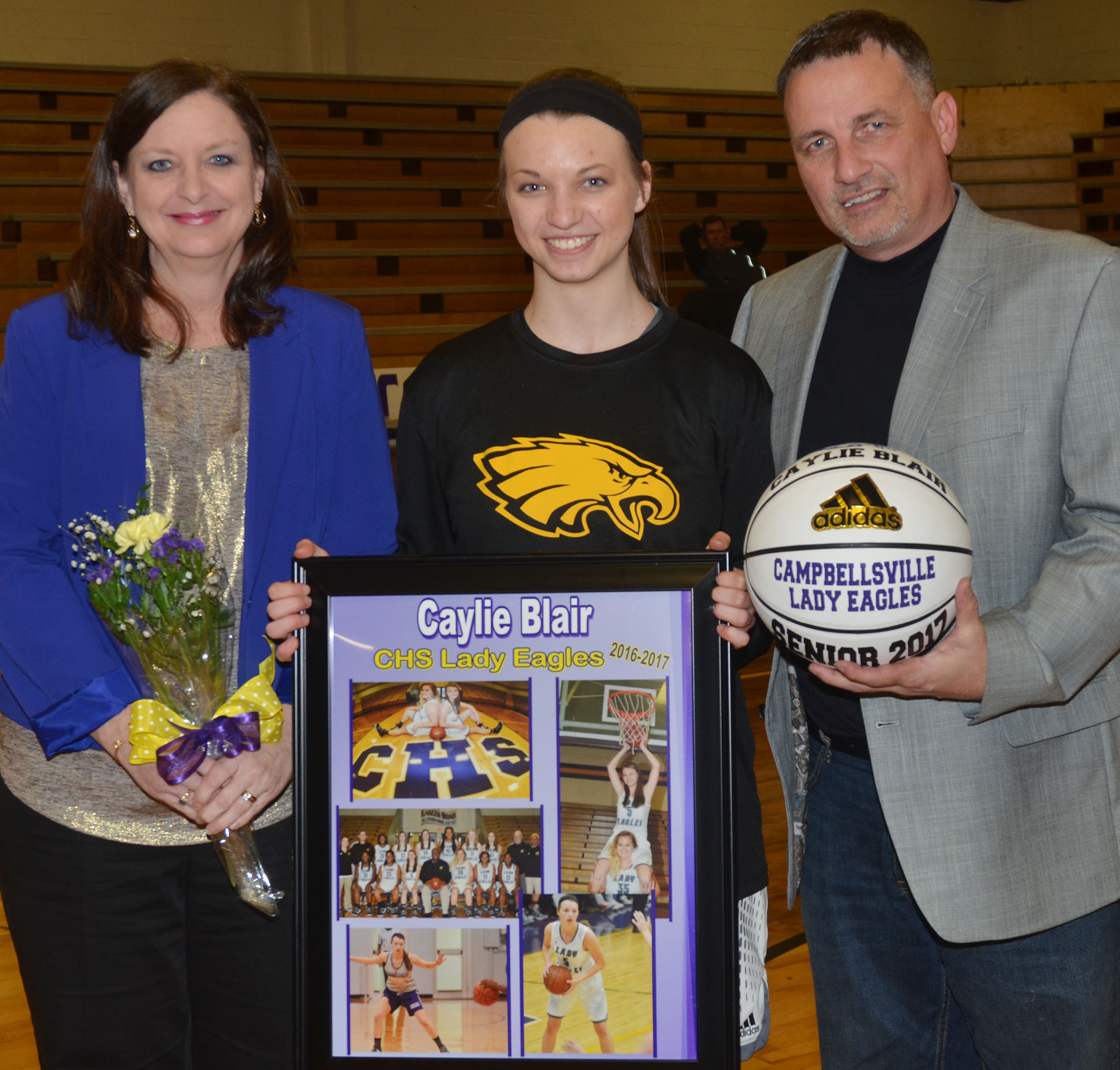 CHS girls' basketball senior player Caylie Blair is honored. She is pictured with her parents, Terri Slinker and Bryan Blair.
