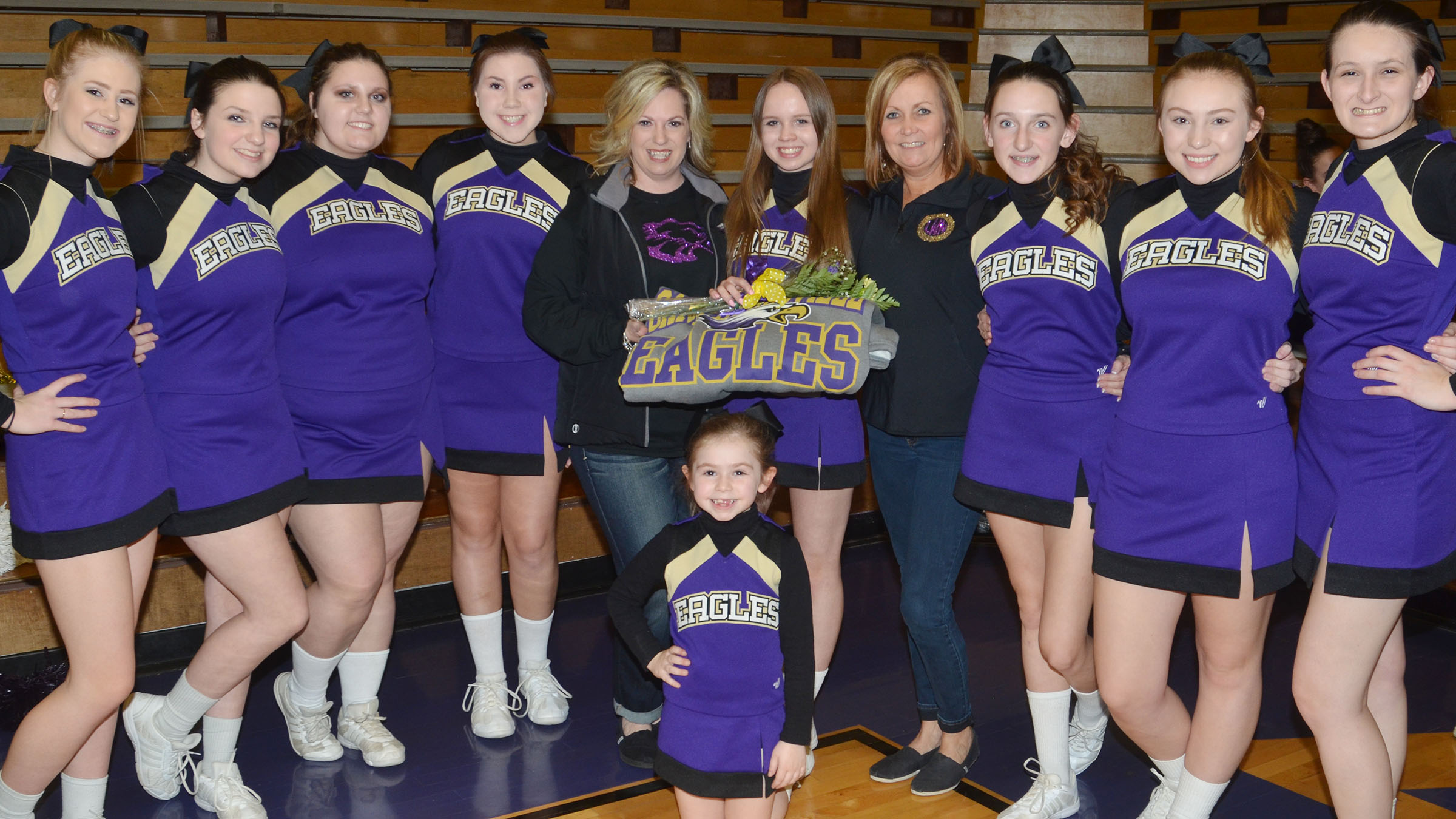 CHS cheerleader Lisa-Marie Richter, a junior and foreign exchange student, is honored. She is pictured with the CHS cheerleading squad. In front is Campbellsville Elementary School first-grader Lainey Price. In back, from left, are freshmen Isabella Osborne and Sydney Wilson, sophomore Andrea Bryant, freshman Lauryn Agathen, coach Nikki Price, Lisa, coach Lisa Wiseman, freshmen Zoe McAninch and Bailey Smith and junior Kimberly Harden.