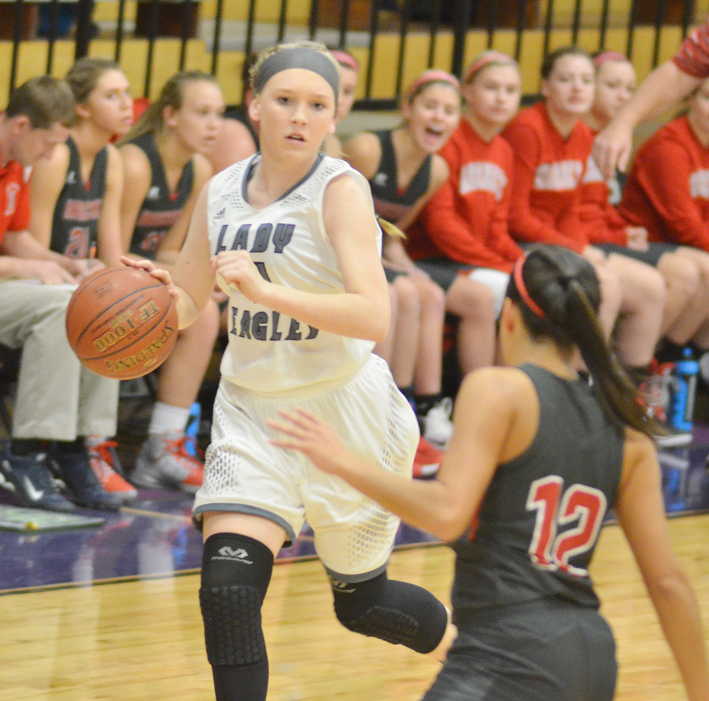 Campbellsville Middle School eighth-grader Catlyn Clausen dribbles to the hoop.