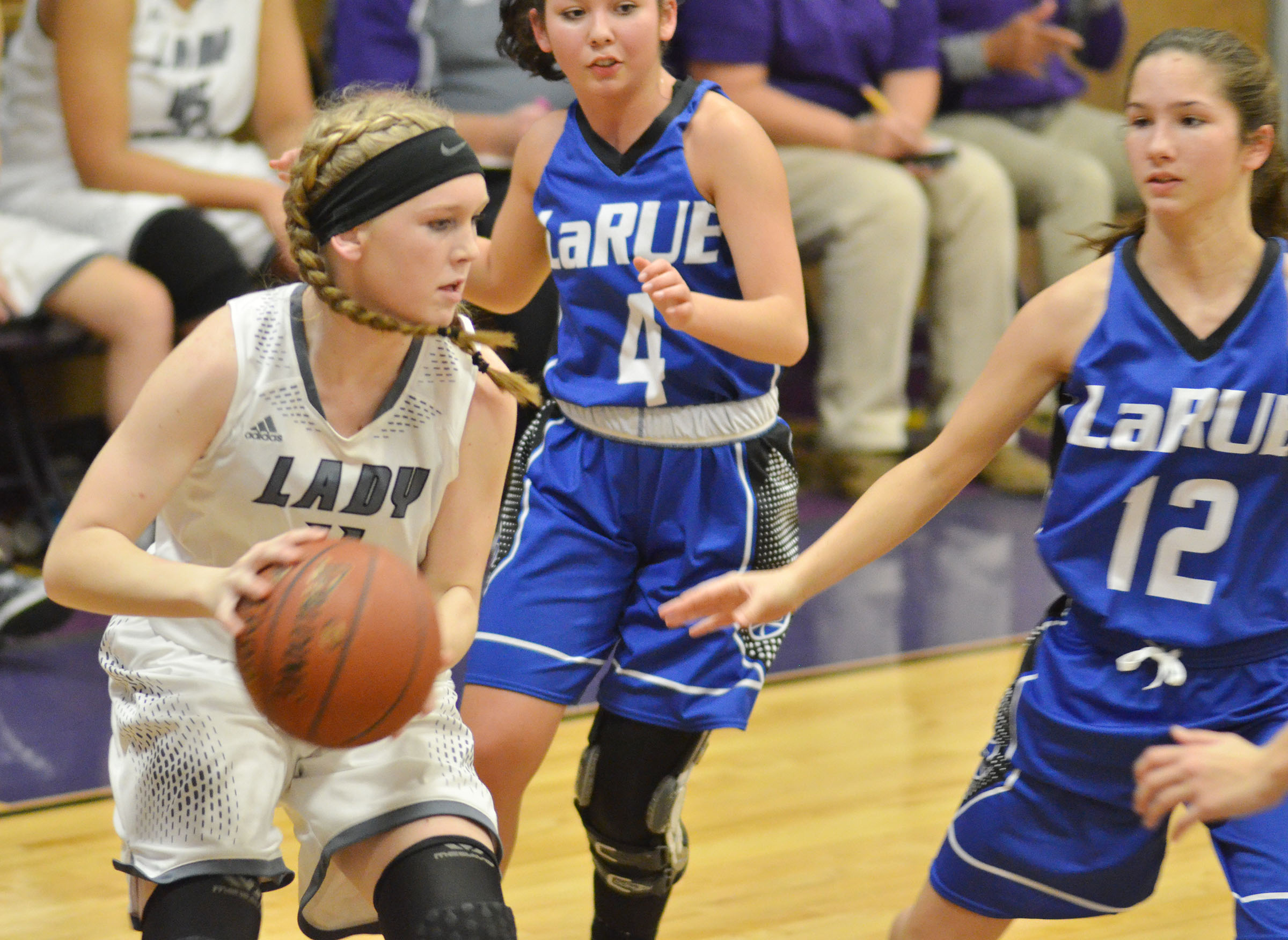 Campbellsville Middle School eighth-grader Catlyn Clausen drives the ball for two points.