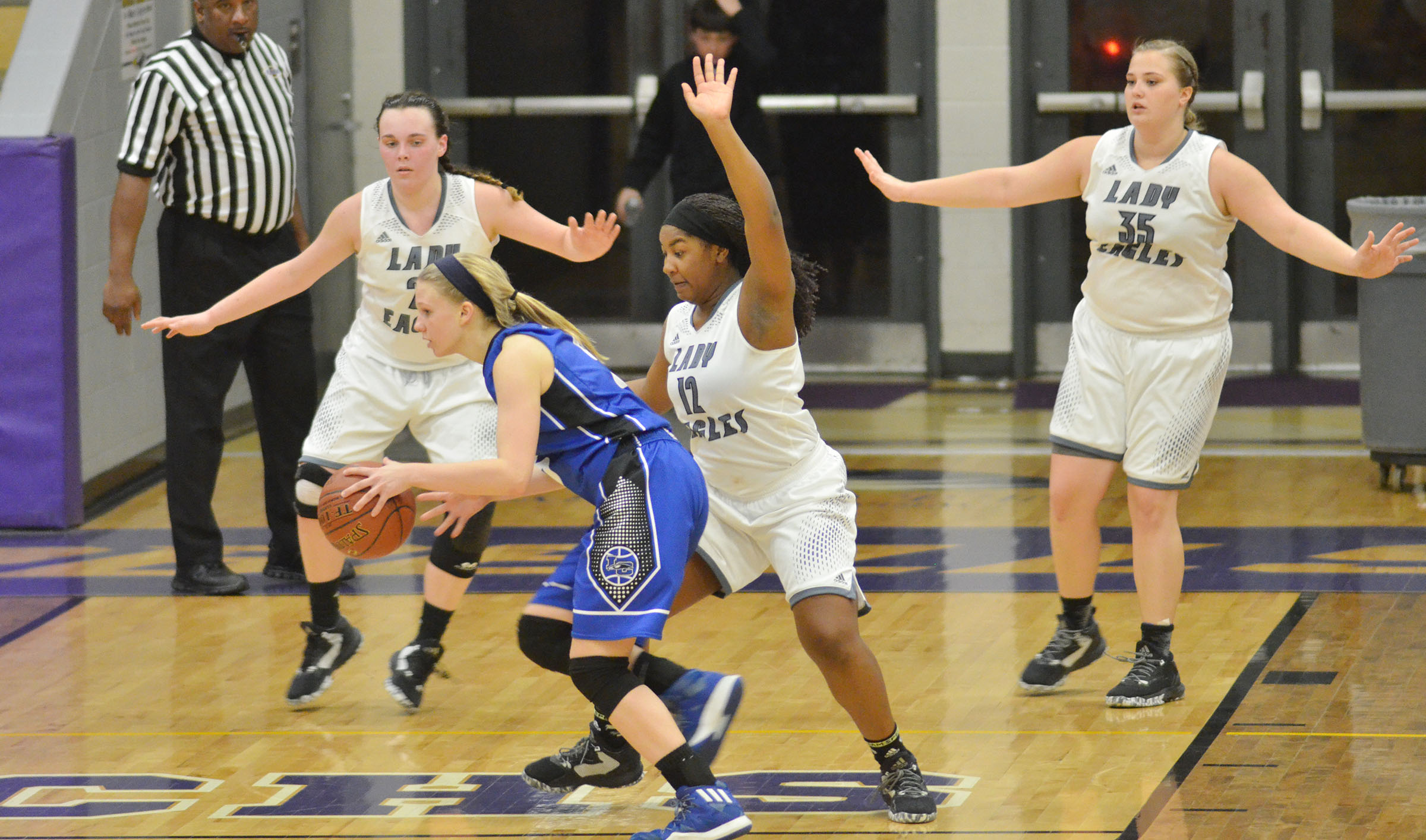 From left, CHS freshman Katelyn Miller, junior Kiyah Barnett and senior Brenna Wethington play defense.