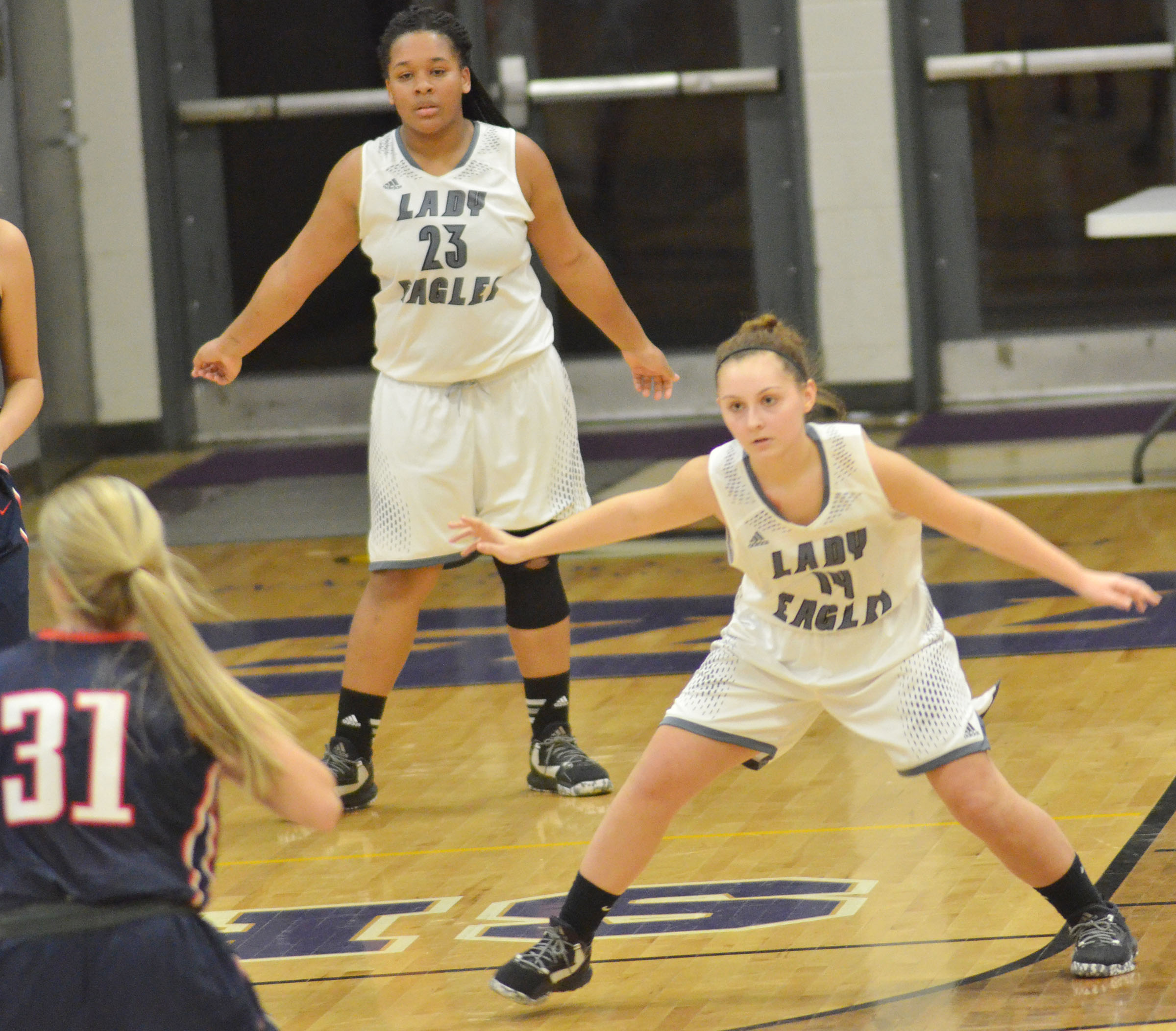 CHS sophomore Reagan Knight, in front, and junior Kayla Young play defense.