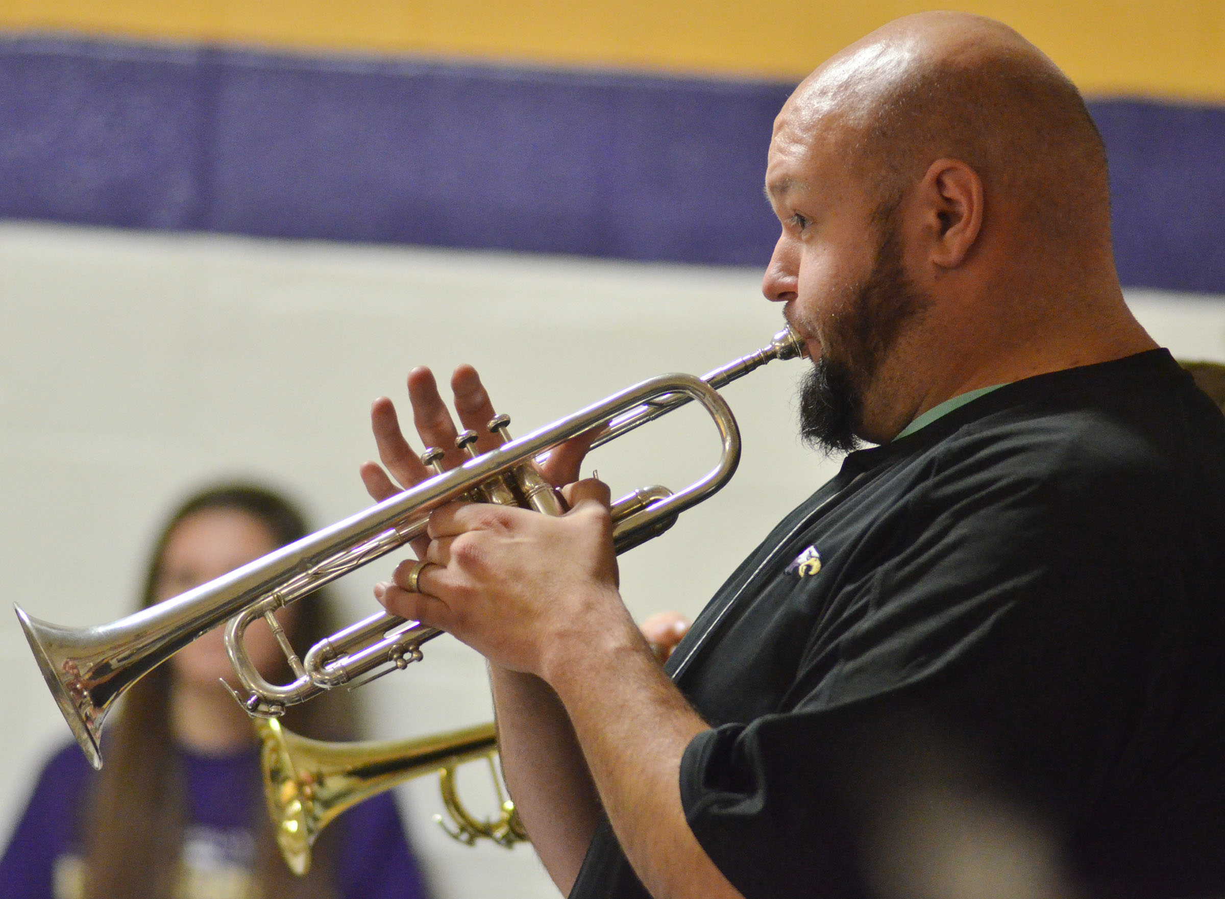 CHS Band Director Zach Shelton plays trumpet with the Pep Band.