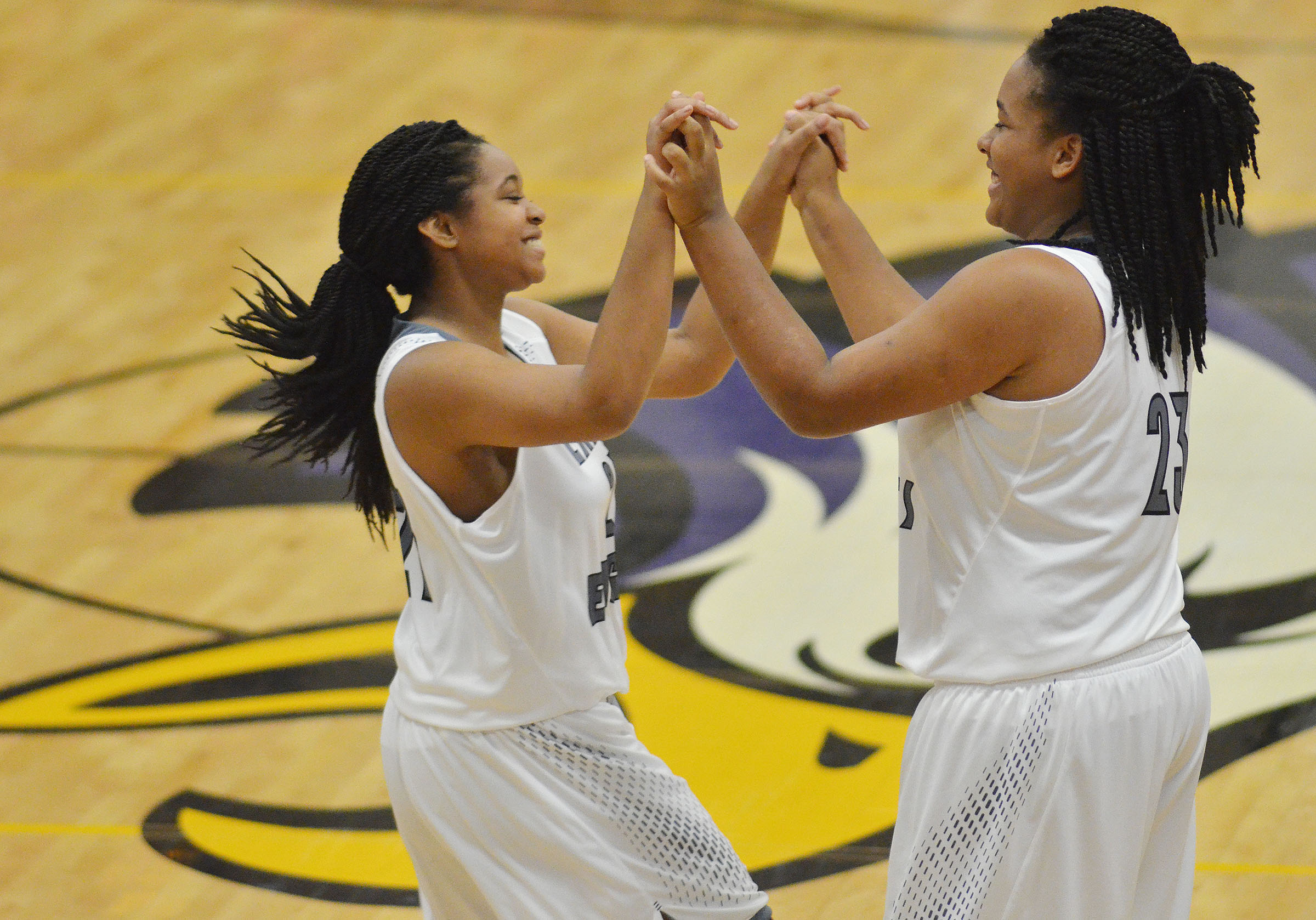 CHS junior Kayla Young, at left, high fives starter Vonnea Smith, also a junior, as she is introduced.