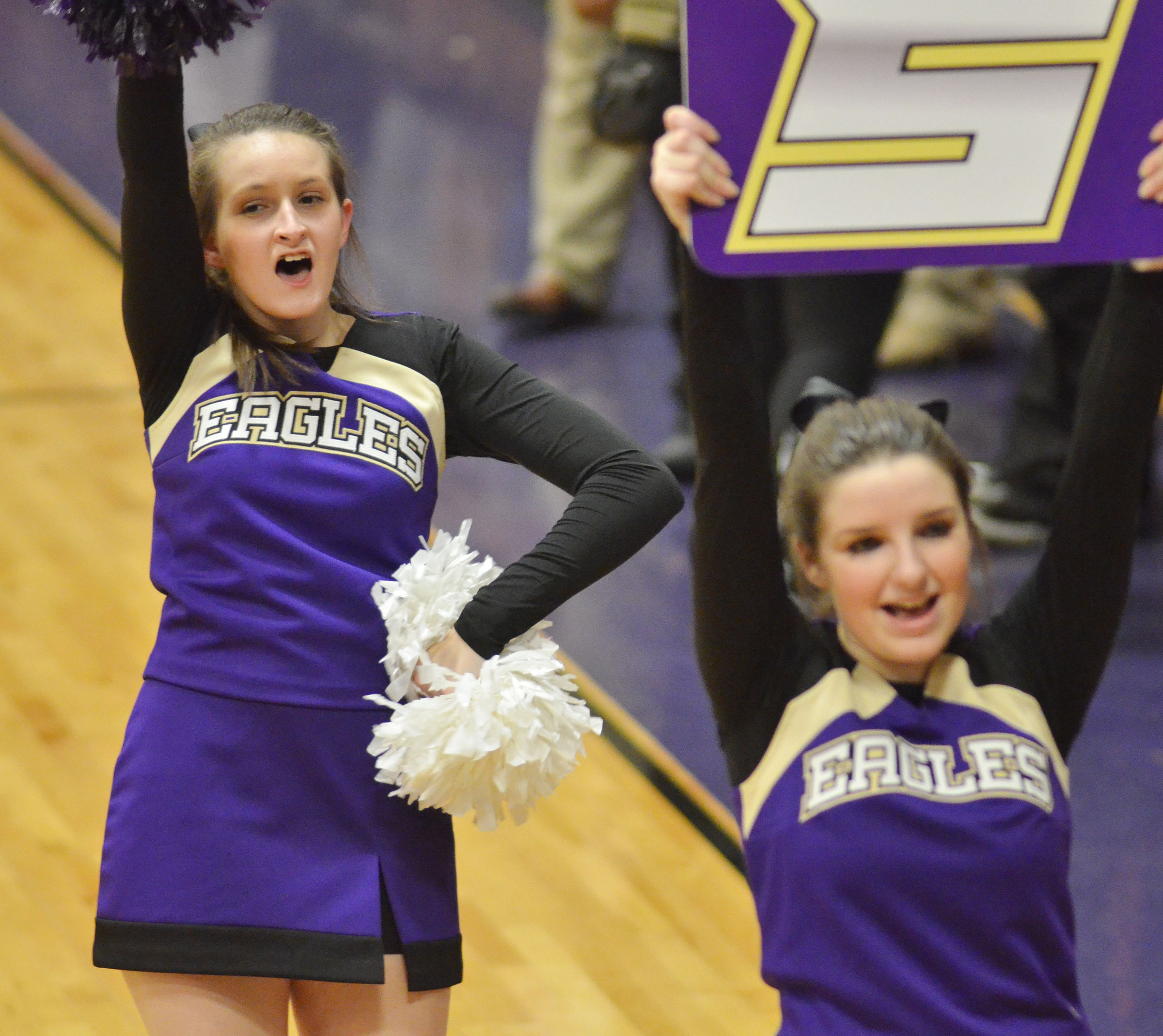 CHS junior Kimberly Harden, at left, and freshman Sydney Wilson cheer for the Eagles.
