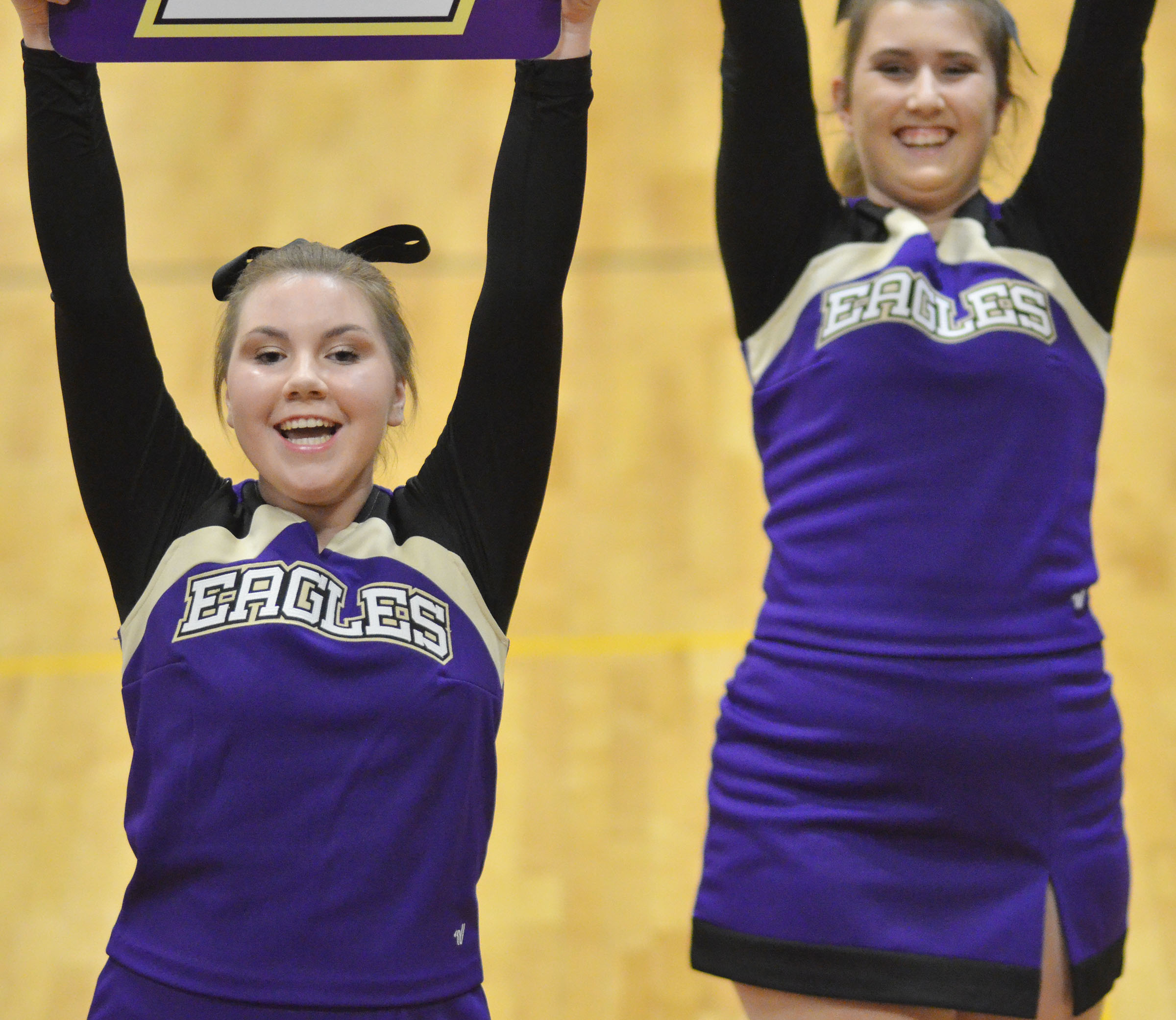 CHS freshman Lauryn Agathen, at left, and junior Jenny Lantz cheer for the Eagles.