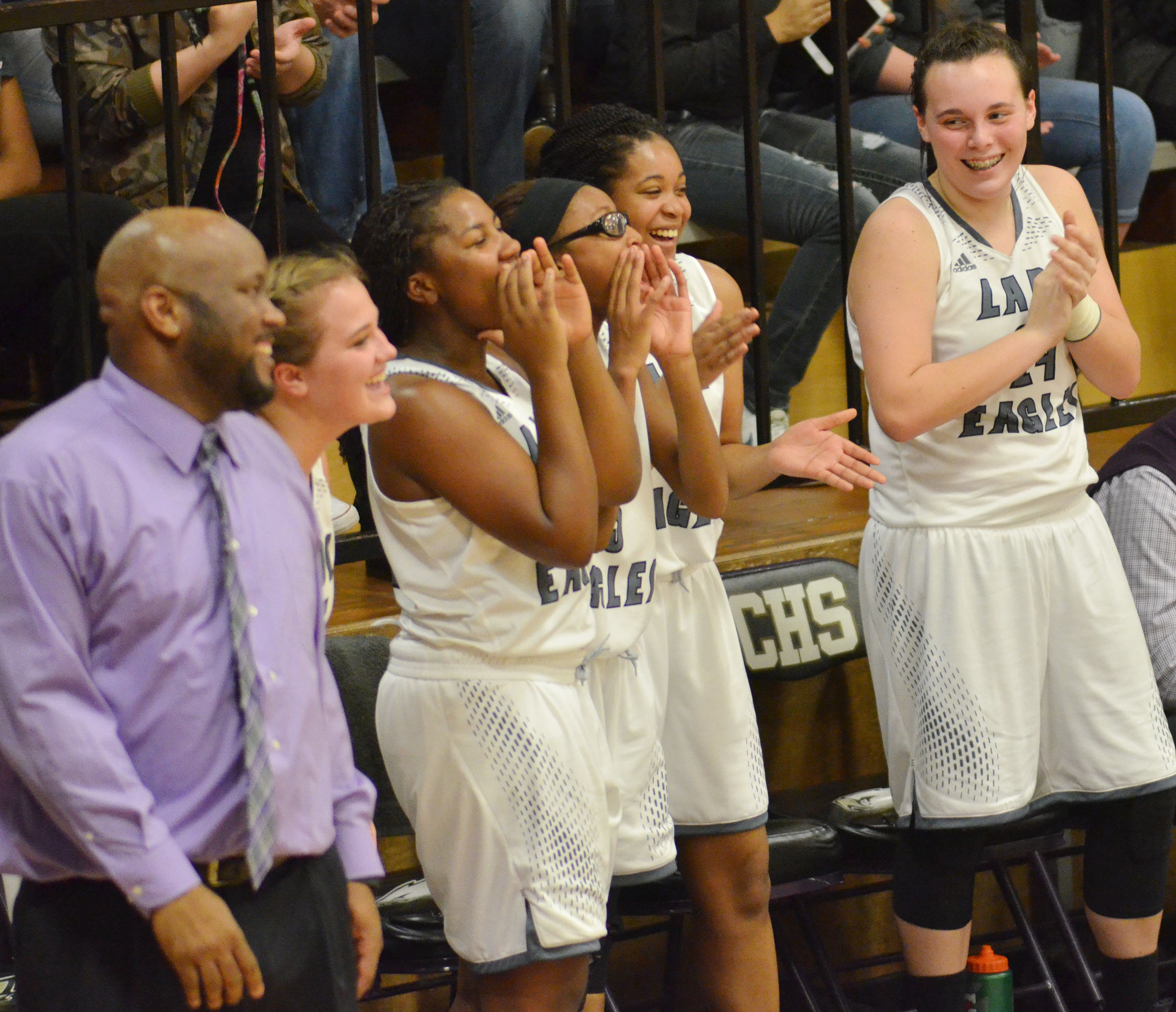 CHS girls' basketball players cheer as they defeat Taylor County.