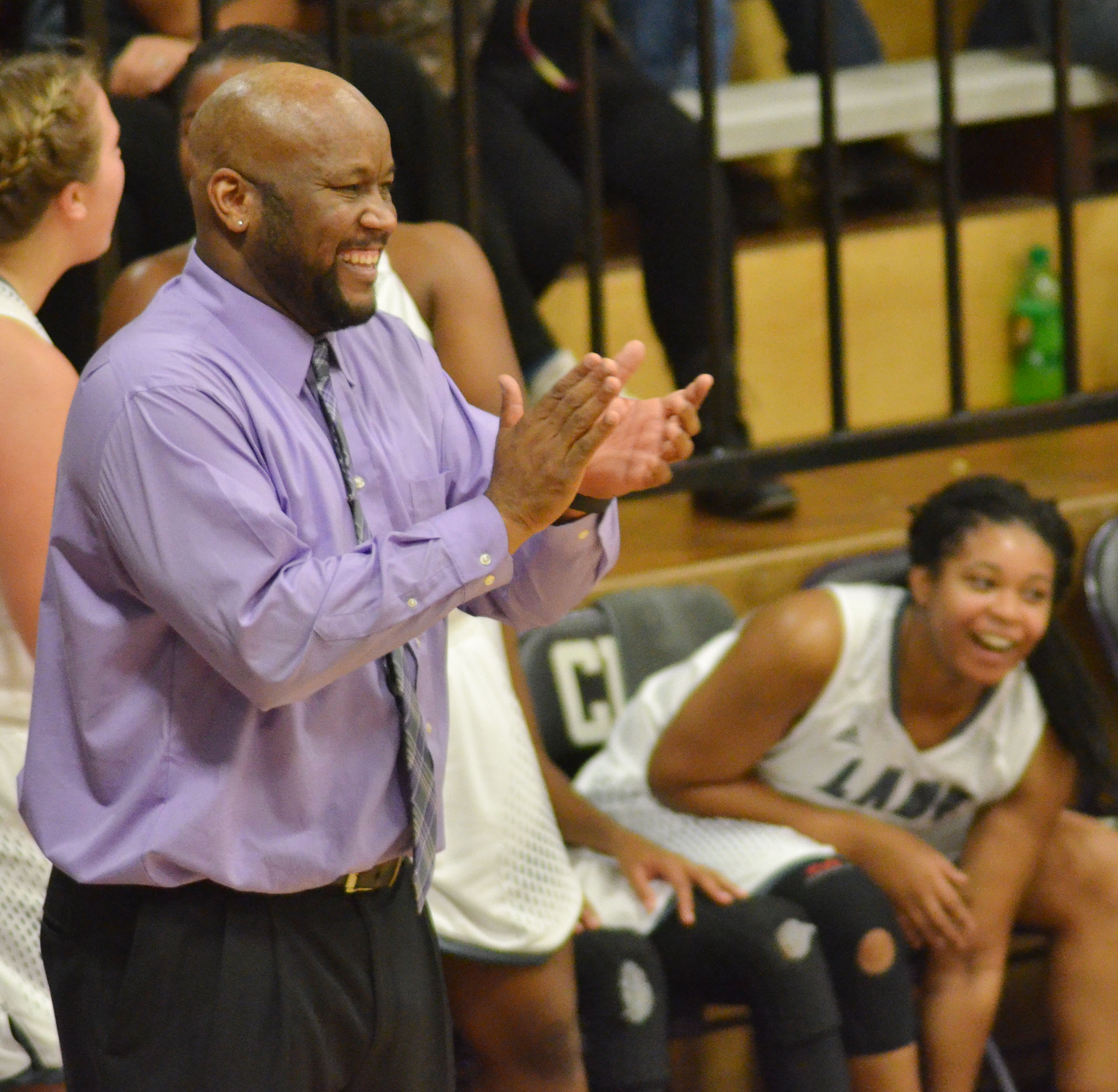 CHS girls' head coach Anthony Epps claps as his team defeats Taylor County.