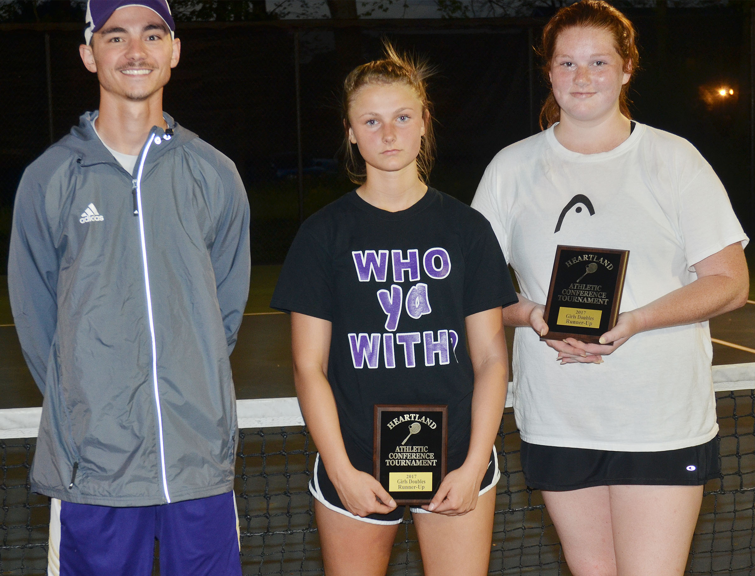 CHS girls' tennis doubles partners senior Mallory Haley and freshman Victoria Cox were this year's Heartland Conference runners-up. From left are coach Bradley Harris, Cox and Haley.