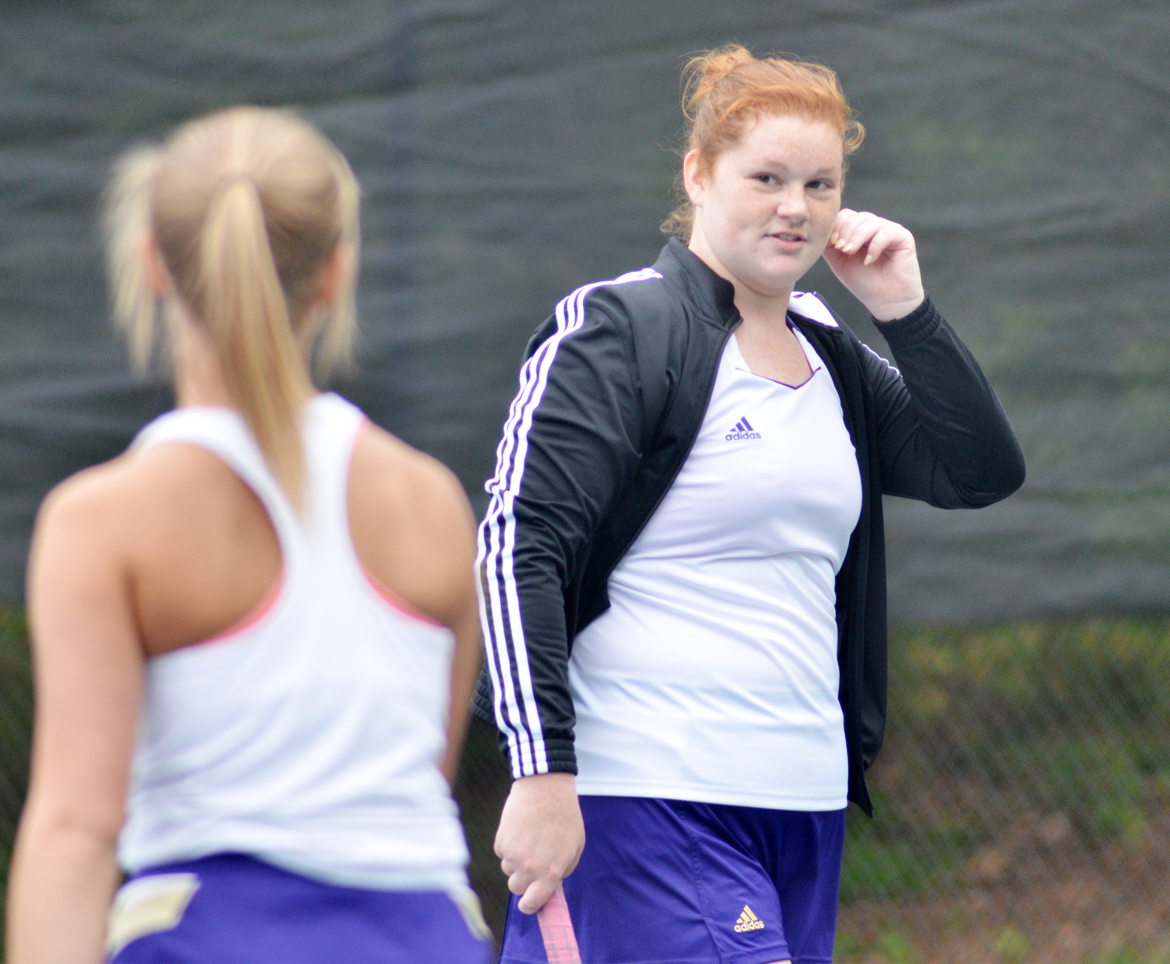 CHS senior Mallory Haley talks with doubles partner freshman Victoria Cox.