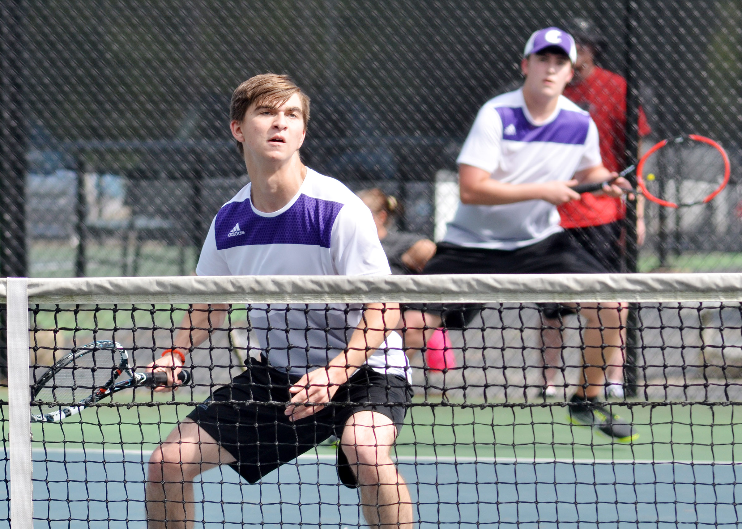 CHS doubles partners Cass Kidwell, a junior, in front, and senior Zack Settle keep their eyes on the ball.