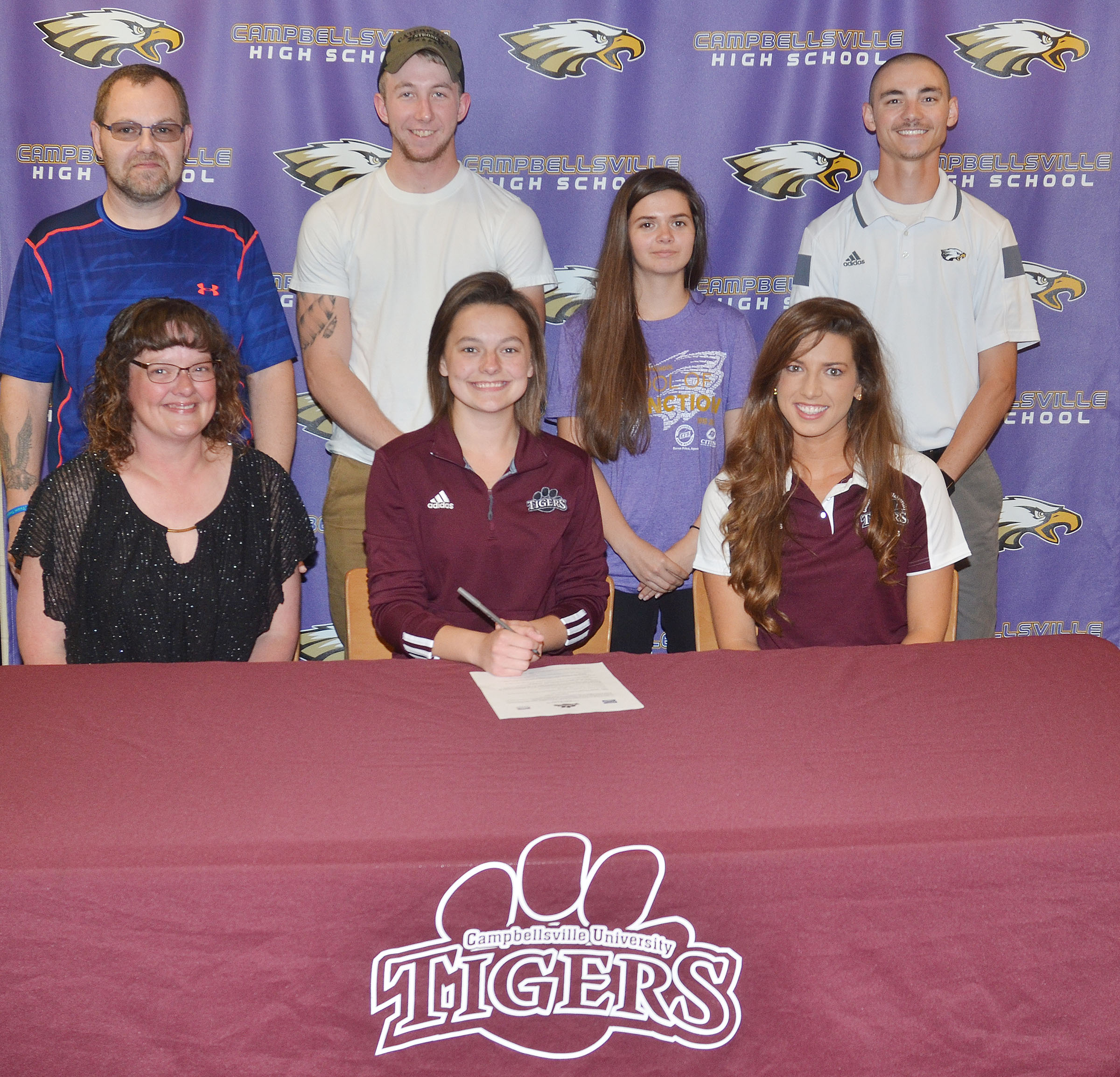 Campbellsville High School senior Kyrsten Hill will continue her academic and tennis career at Campbellsville University this fall. She recently signed her letter of intent in a special ceremony with her family, friends, teammates and coaches. From left, front, are Hill's mother Tonya, Hill and CU head tennis coach Kristen Hamrick. Back, Hill's father Jonathan, Hill's boyfriend Chanse Jernigan, Hill's tennis teammate Shauna Jones, who is also a senior, and CHS tennis coach Bradley Harris.