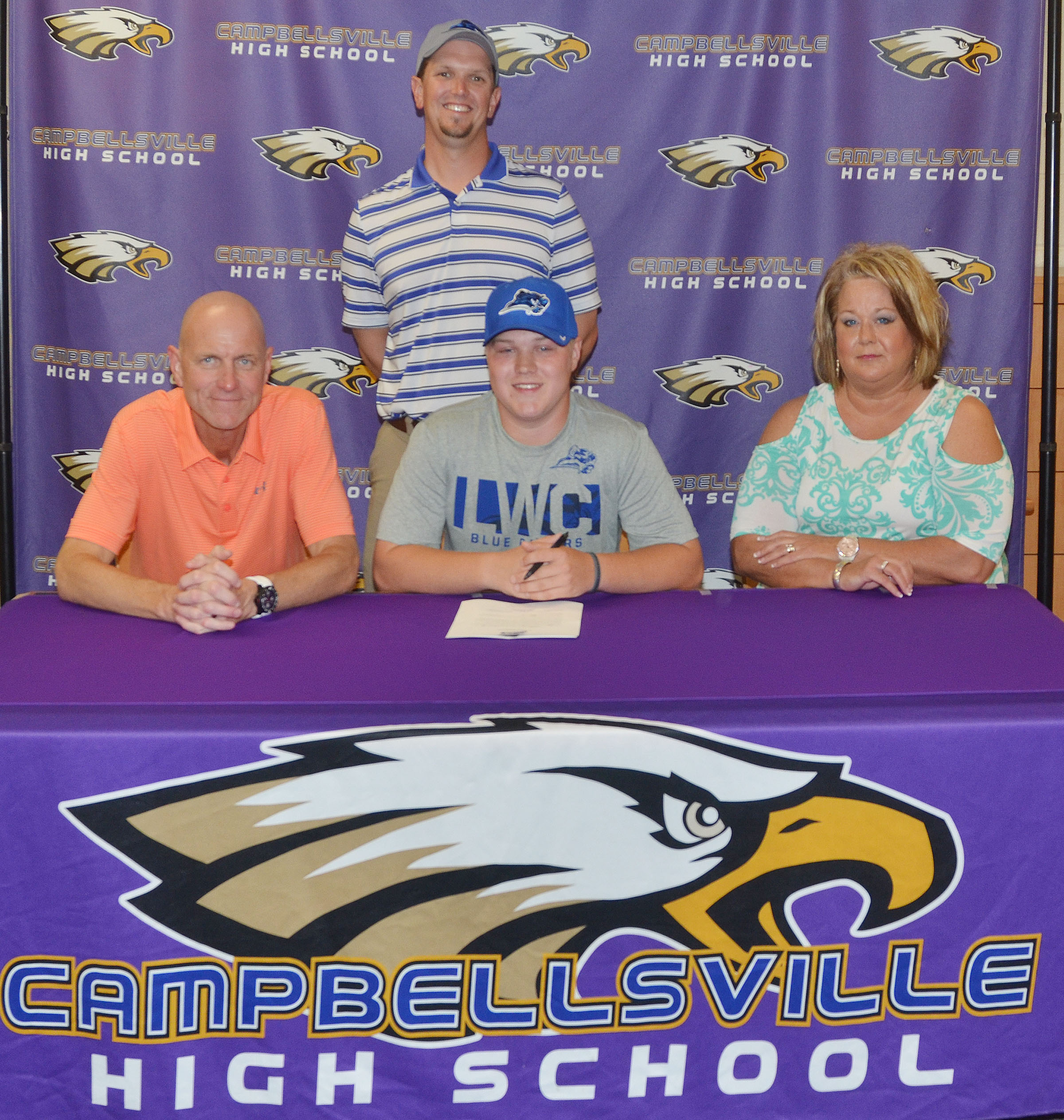 Campbellsville High School senior Noah Wagers will continue his academic and golf career this fall at Lindsey Wilson College. Wagers recently signed his letter of intent in a special ceremony with family, friends, teammates and coaches. From left are his parents, Steve and Kim Wagers, and in back is LWC golf coach Eric Wyrick.