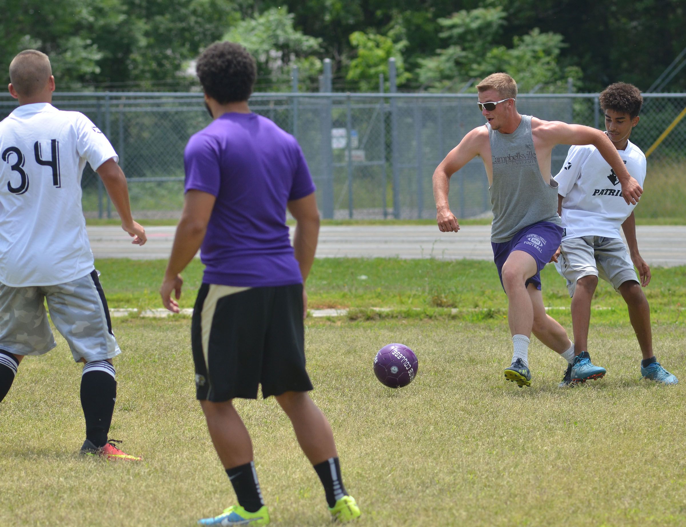 CHS soccer alumni player Logan Dial kicks the ball.