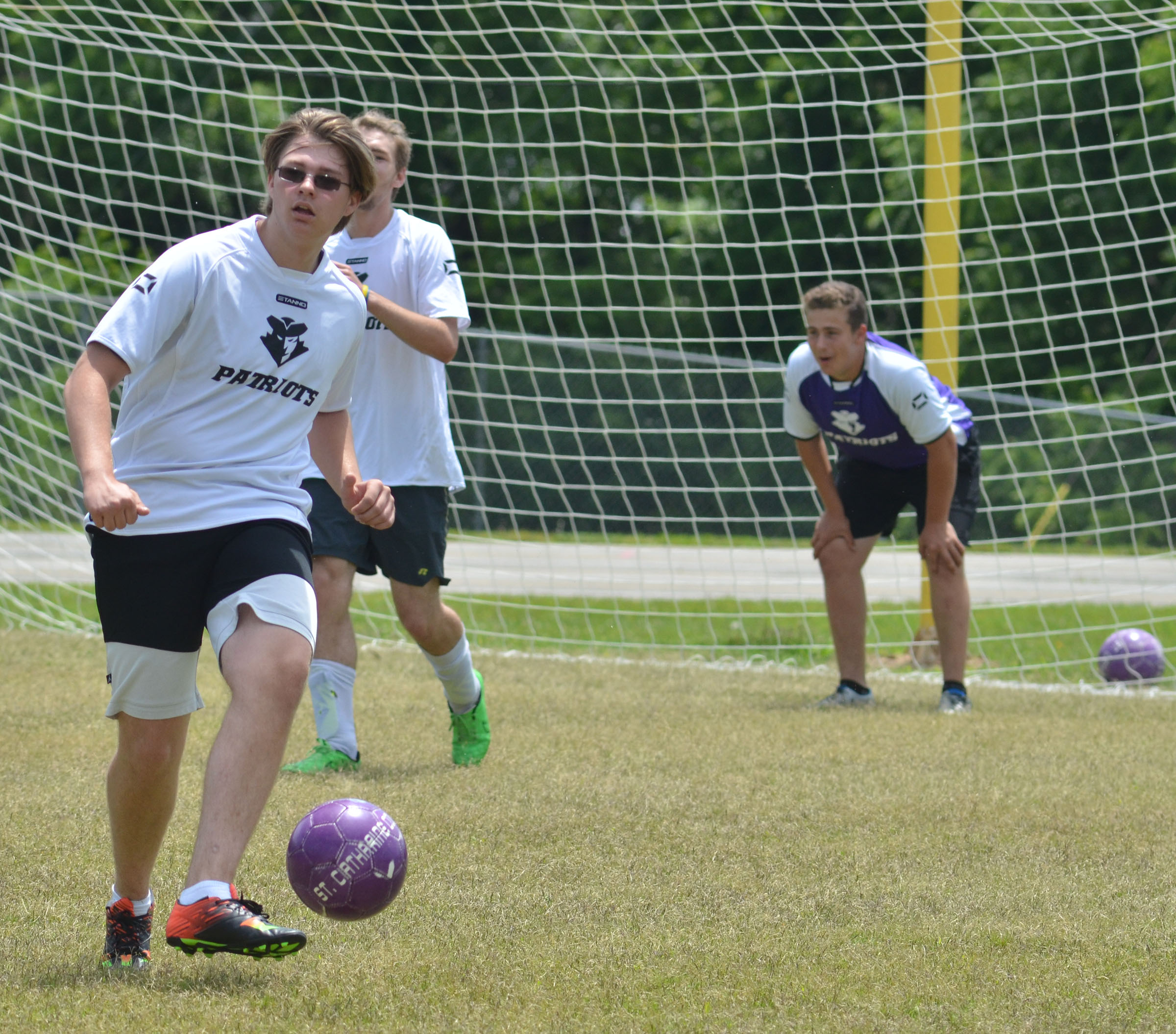 CHS junior Keidlan Boils kicks the ball.