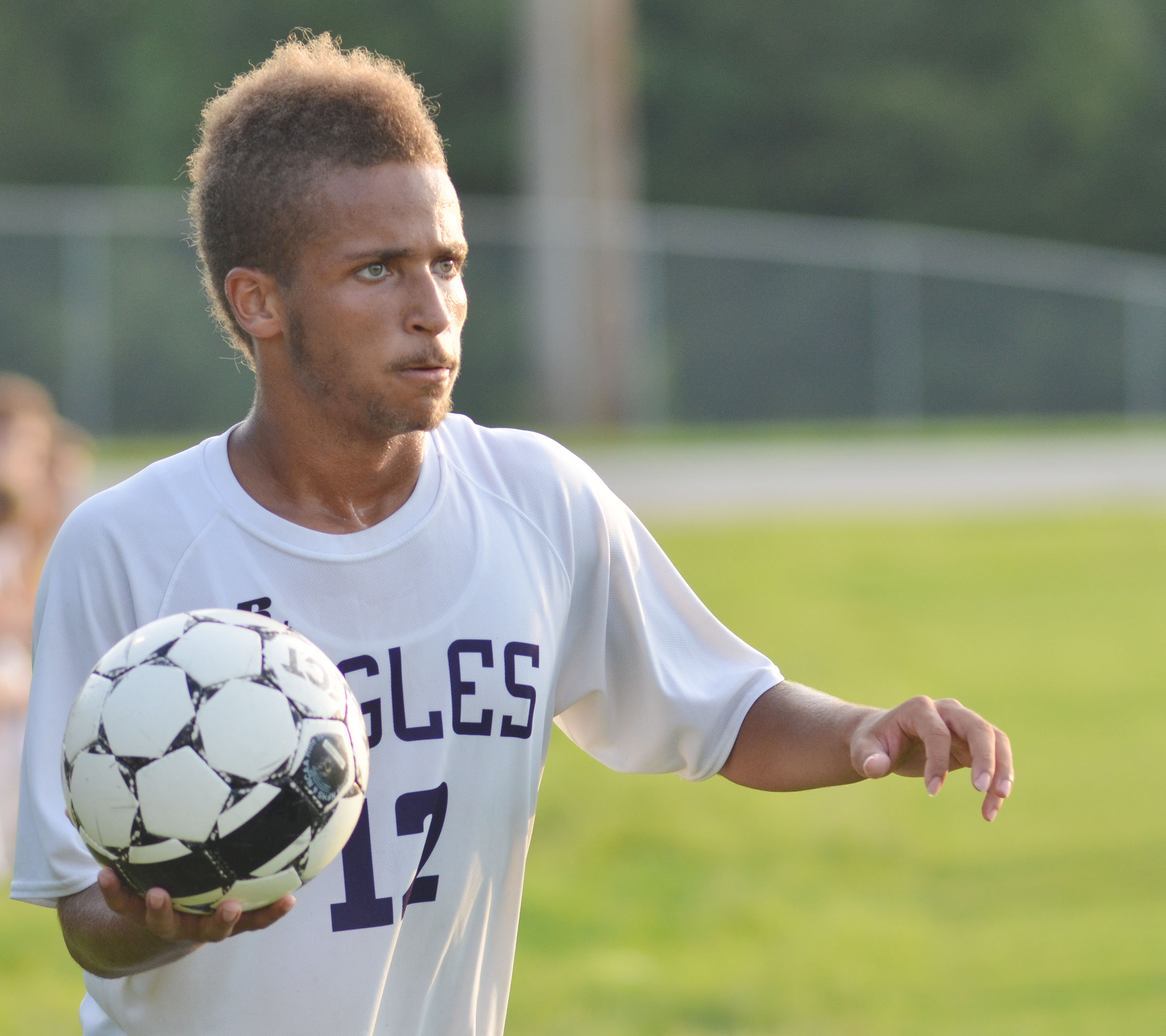 CHS junior Ethan Lay throws the ball to his teammates.
