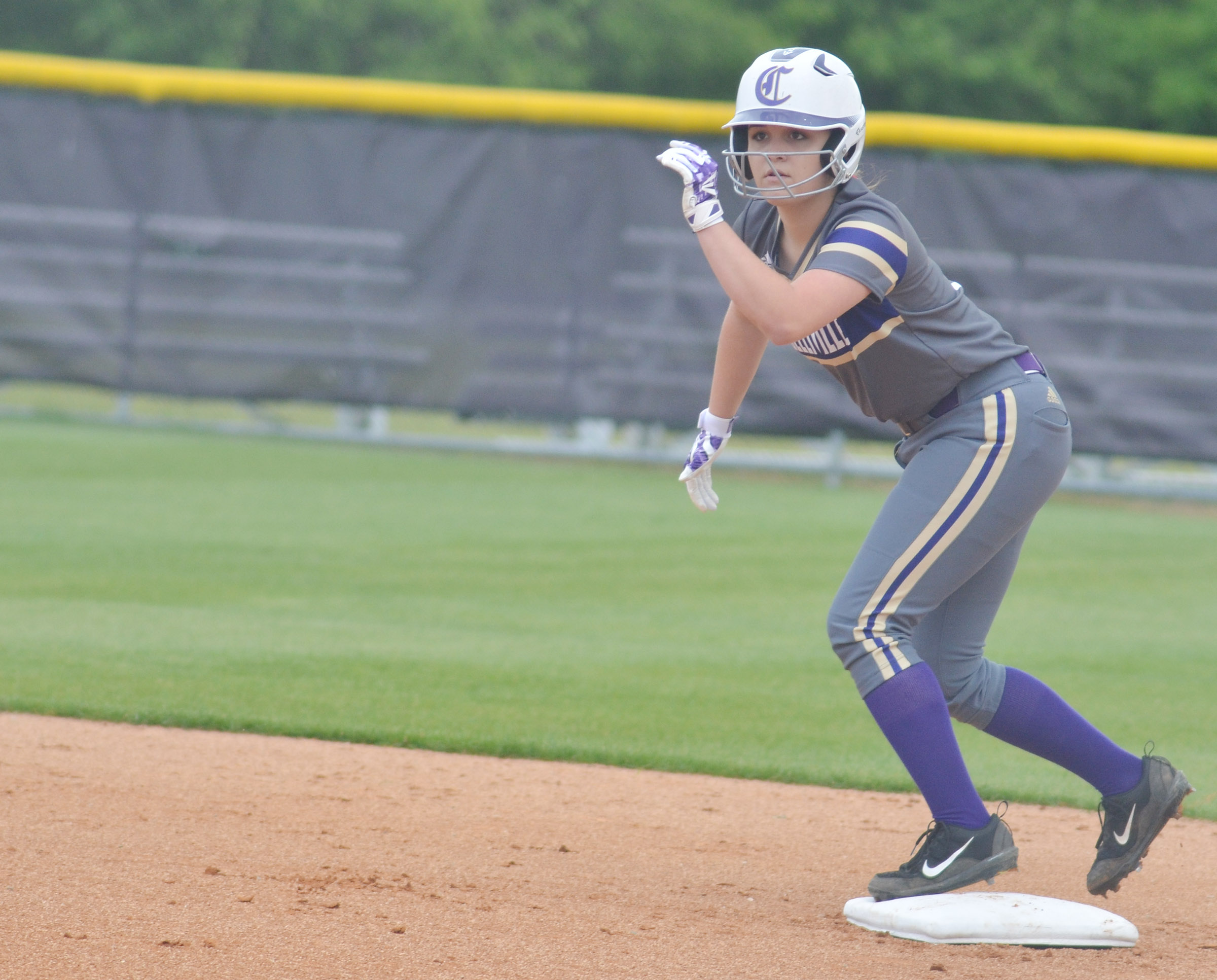 Campbellsville Middle School eighth-grader Kenzi Forbis looks to run to third.