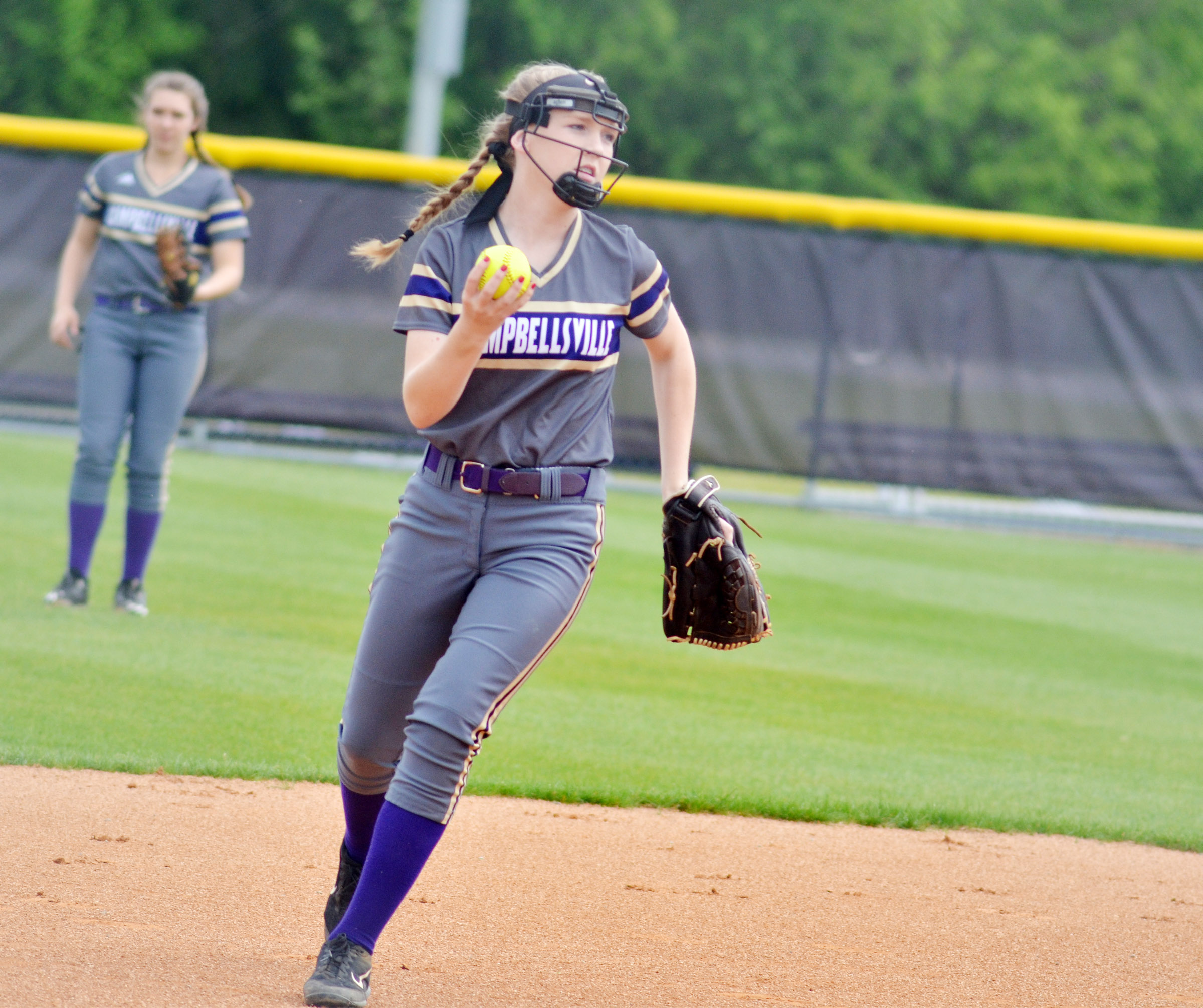 Campbellsville Middle School eighth-grader Catlyn Clausen throws to first.