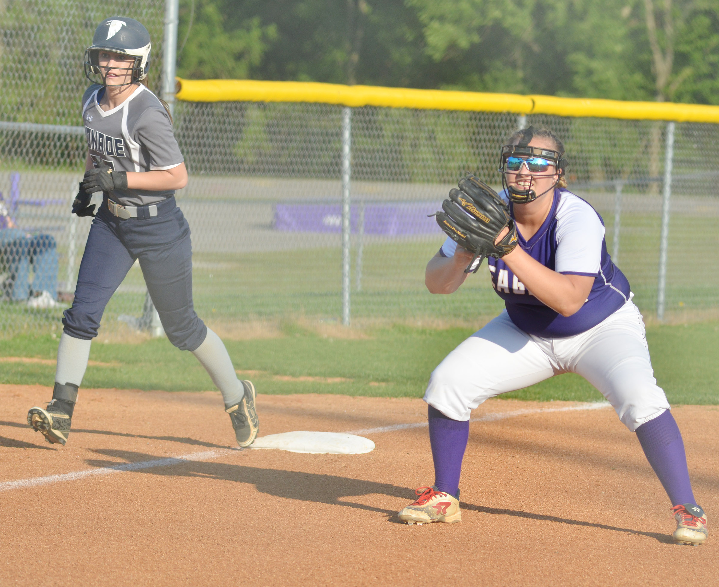 CHS senior Brenna Wethington keeps the runner close on third.