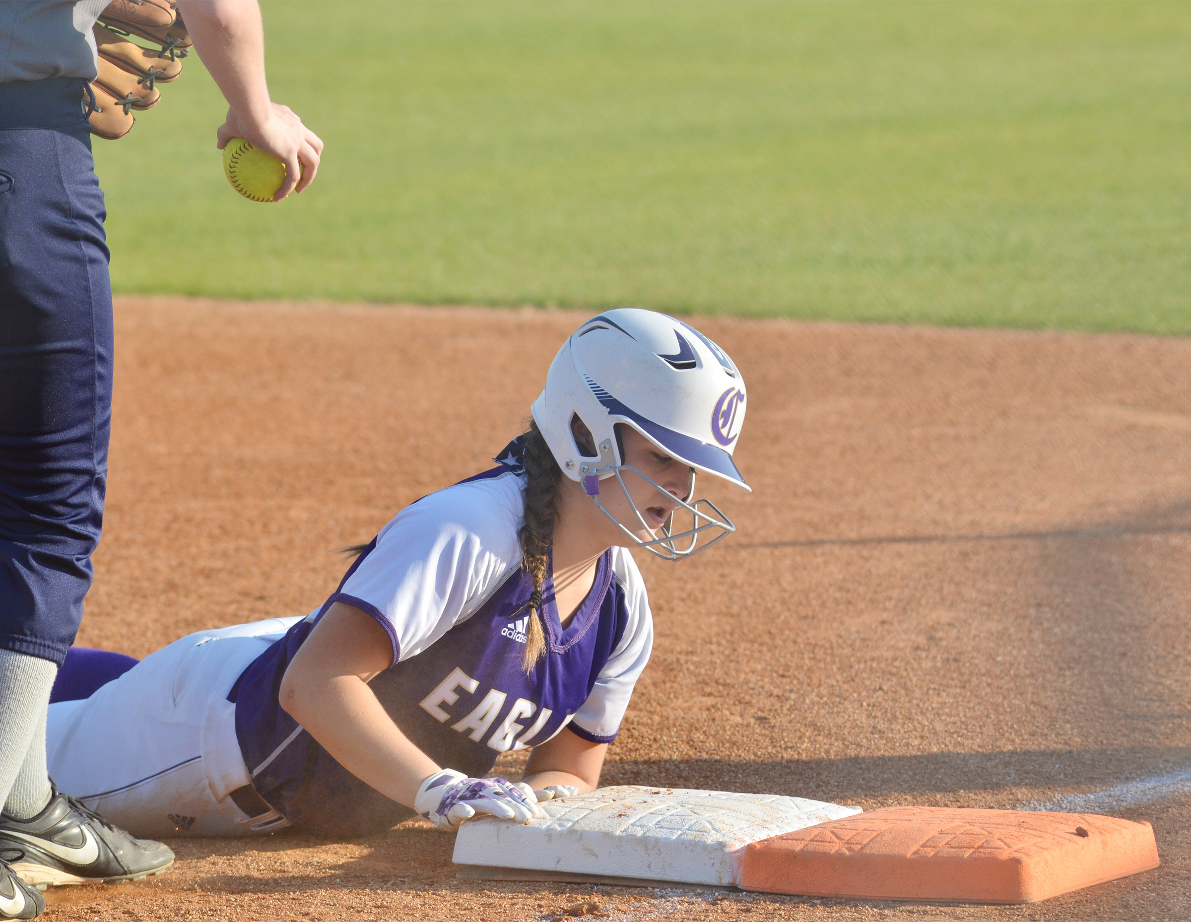 Campbellsville Middle School eighth-grader Kenzi Forbis slides back to first.