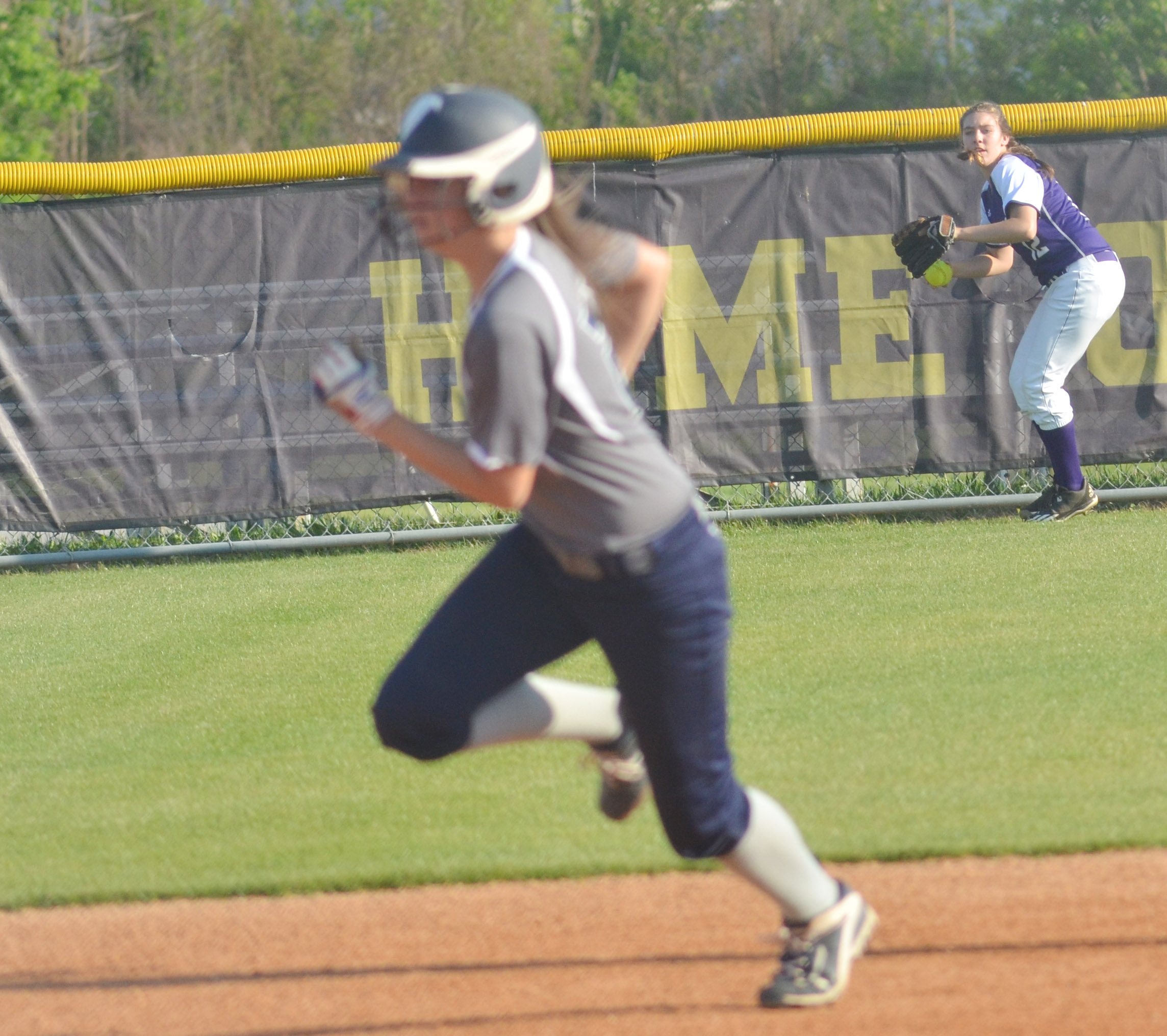 Campbellsville Middle School eighth-grader Abi Wiedewitsch throws to third.