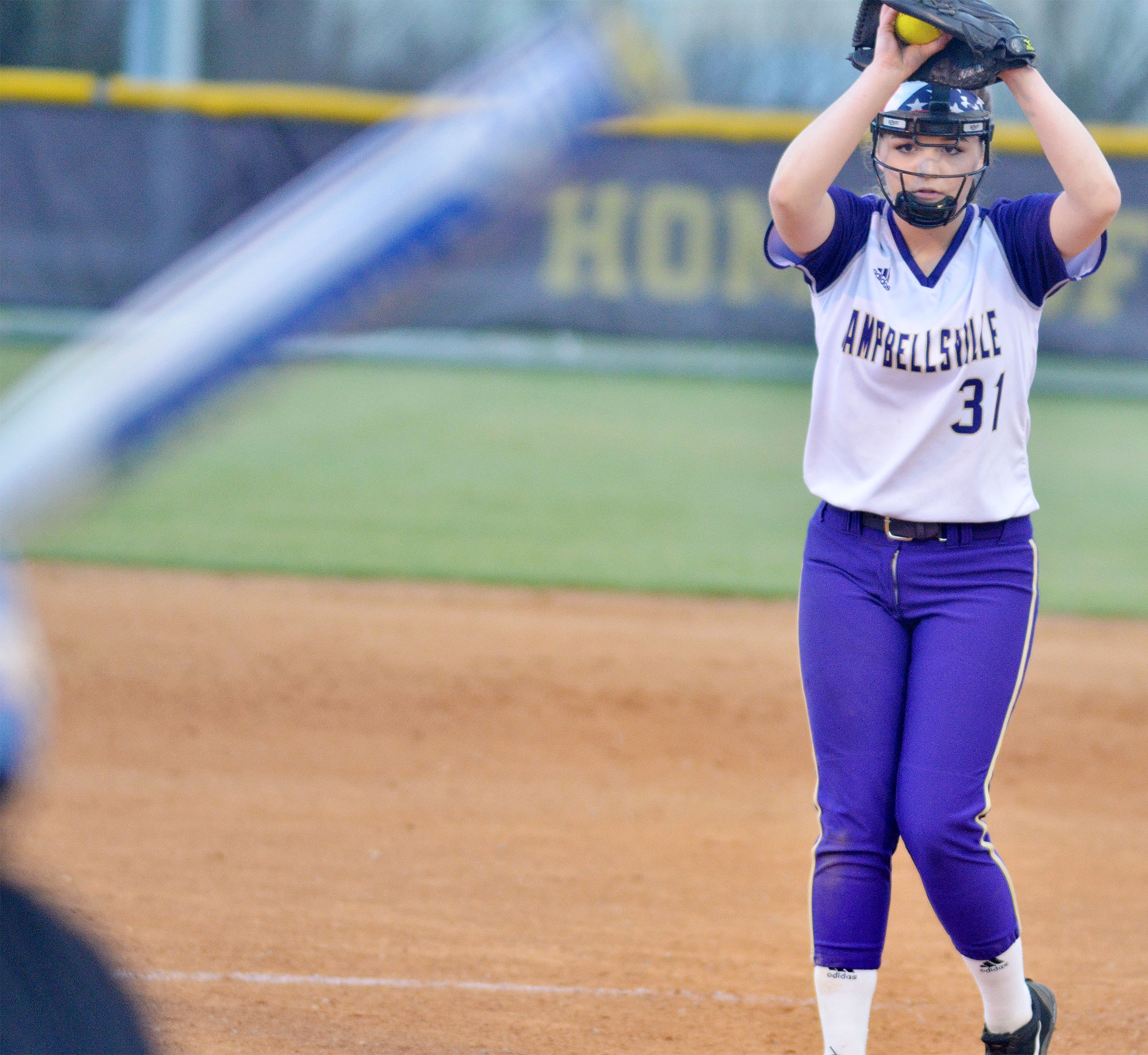 Campbellsville Middle School eighth-grader Kenzi Forbis winds a pitch.