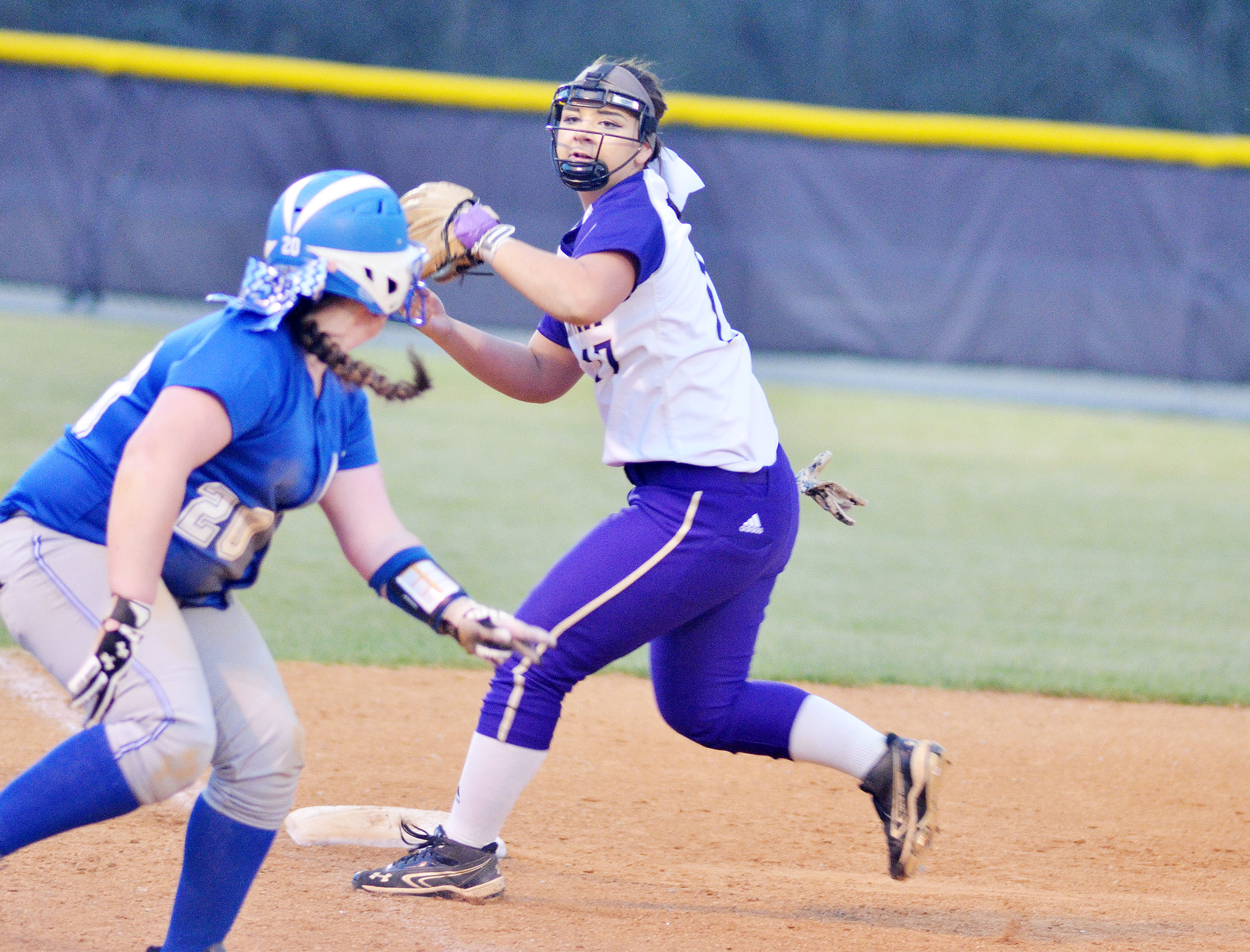 CHS senior Kailey Morris catches the ball and steps on third for a double play.