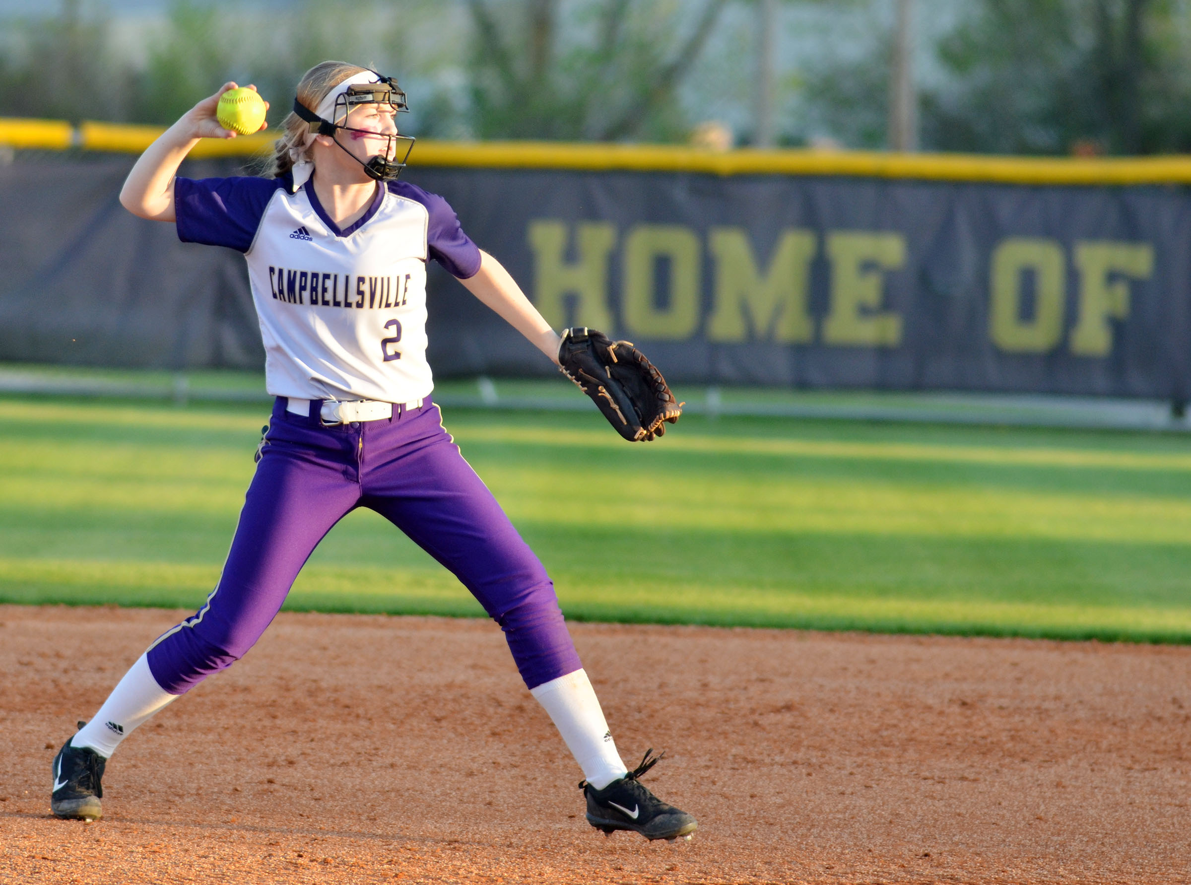 Campbellsville Middle School eighth-grader Catlyn Clausen throws to second.