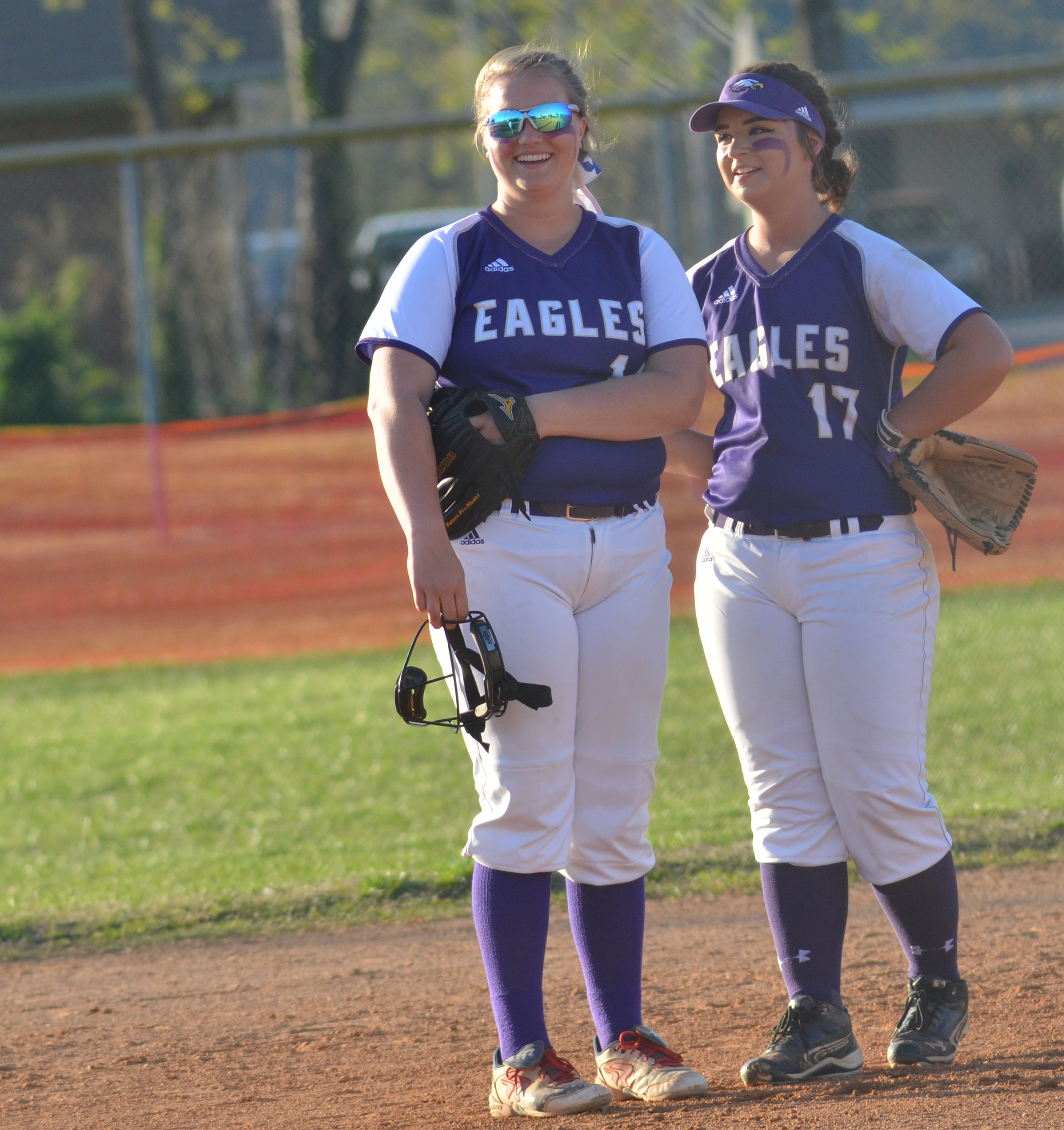 CHS seniors Brenna Wethington, at left, and Kailey Morris share a laugh between innings.