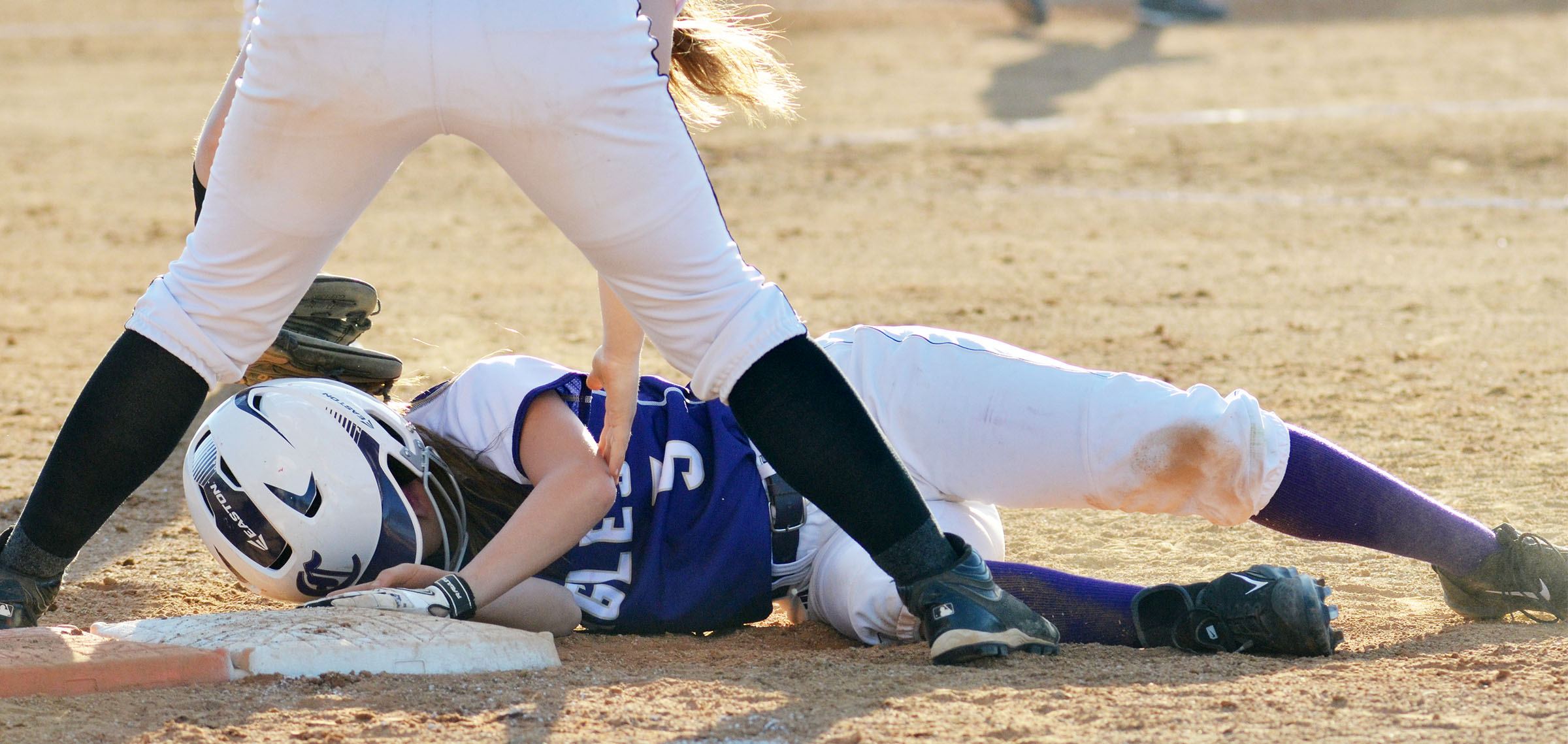 CHS freshman Bailey Thompson slides back to first.