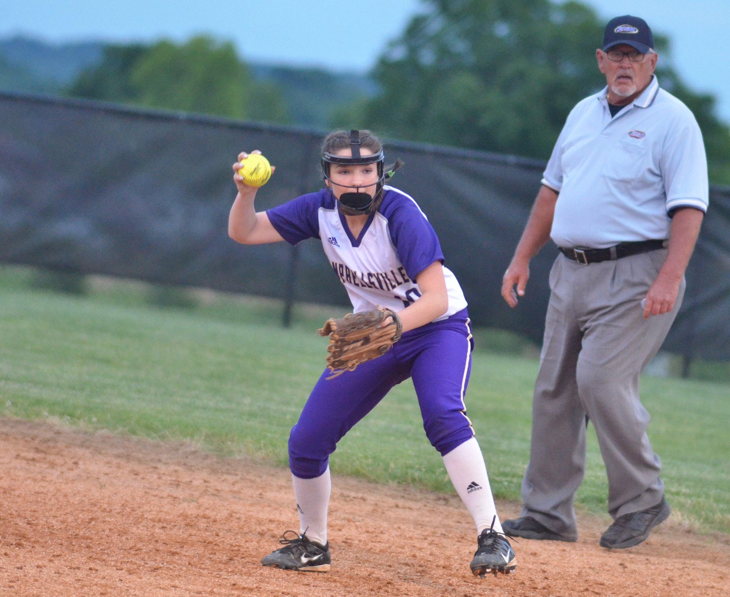 CHS freshman Sydney Wilson throws to first for an out.