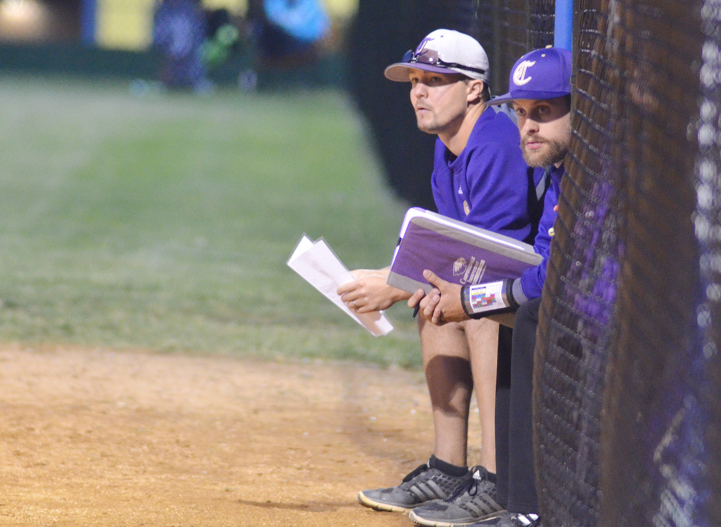 CHS head softball coach Weston Jones, at left, and assistant coach Matt Schmuck watch their players.
