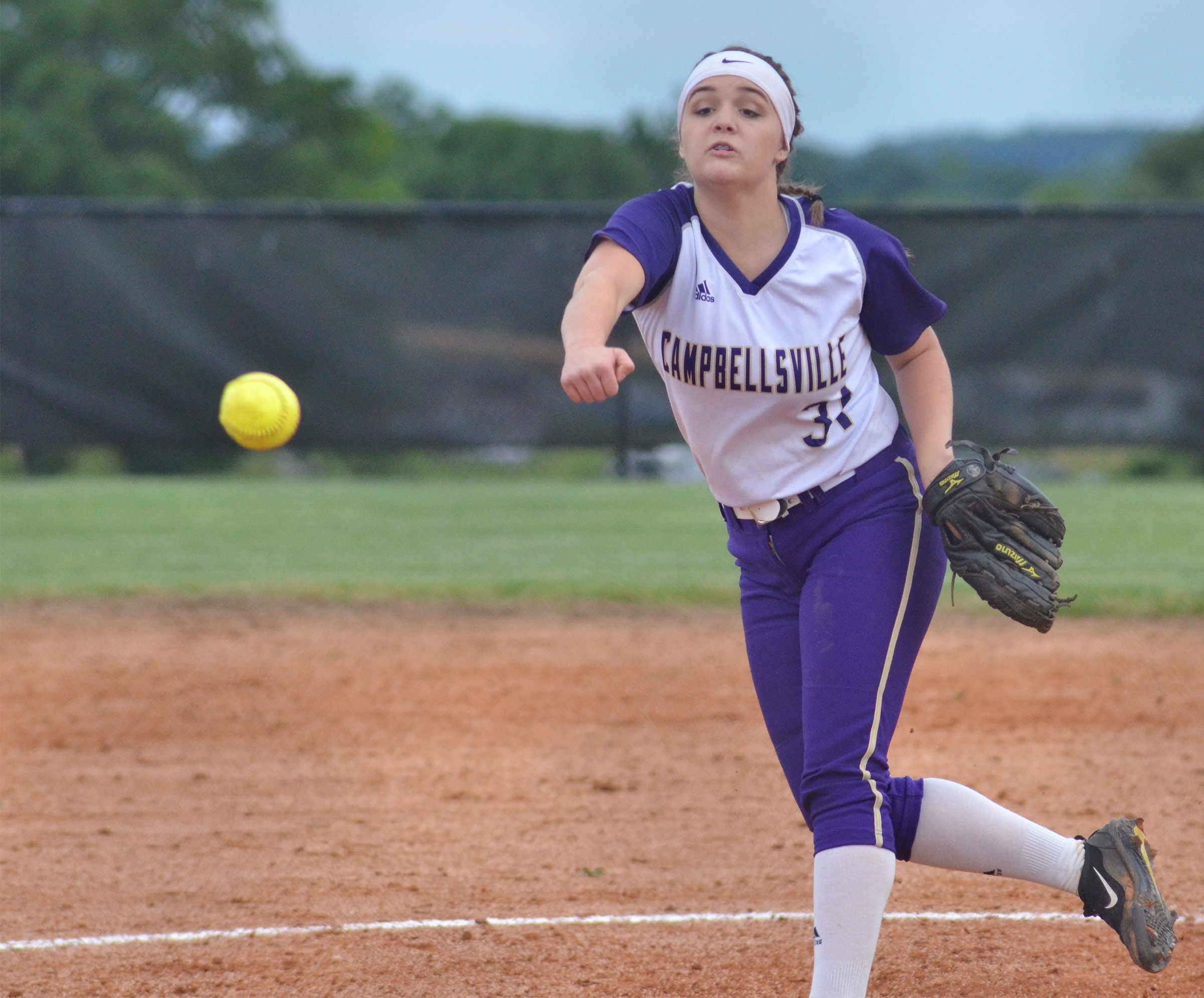 Campbellsville Middle School eighth-grader Kenzi Forbis pitches.