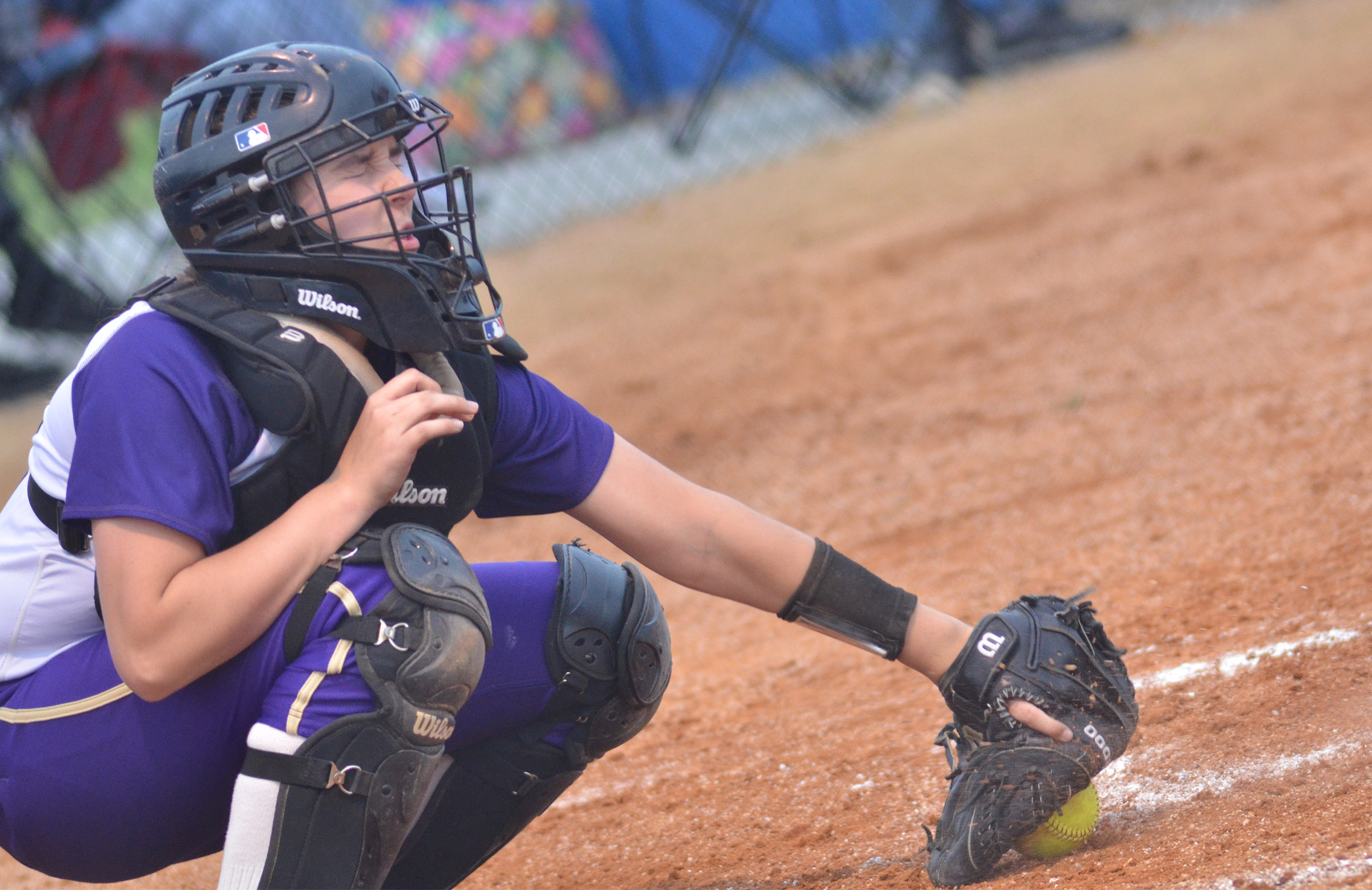 Campbellsville Middle School eighth-grader closes her eyes as she catches the ball.