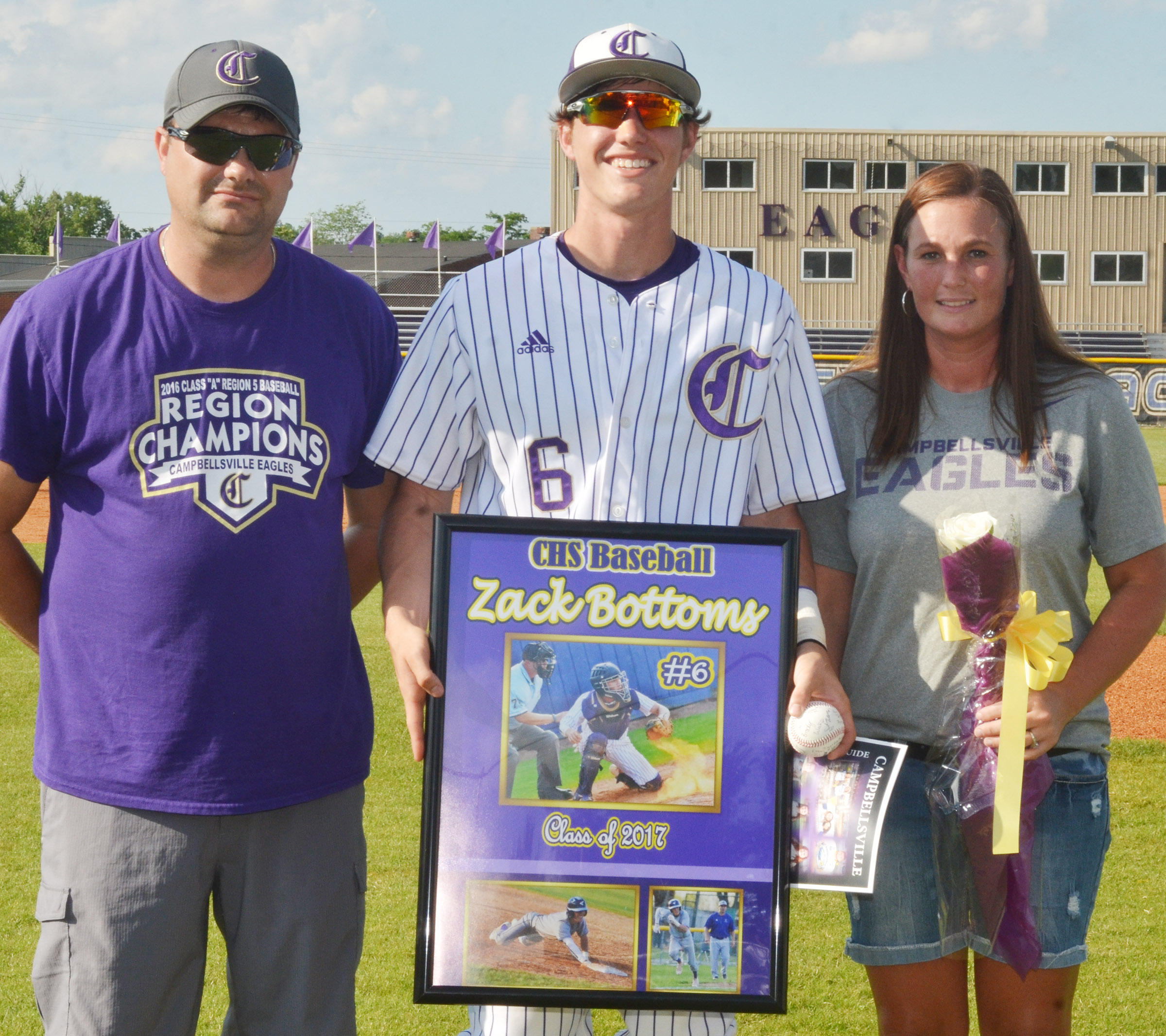 CHS senior Zack Bottoms is honored for his dedication to the CHS baseball team. From left are his father Adam Bottoms, Bottoms and his mother Kecia Bottoms.
