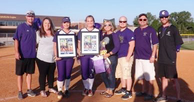 CHS softball players Brenna Wethington and Kailey Morris are honored for her dedication to the CHS softball team. From left are head coach Weston Jones, Morris's mother Leslie, Morris, Wethington, Wethington's mother Shelia, Wethington's brother Mason, Wethington's father John and assistant coach Matt Schmuck.