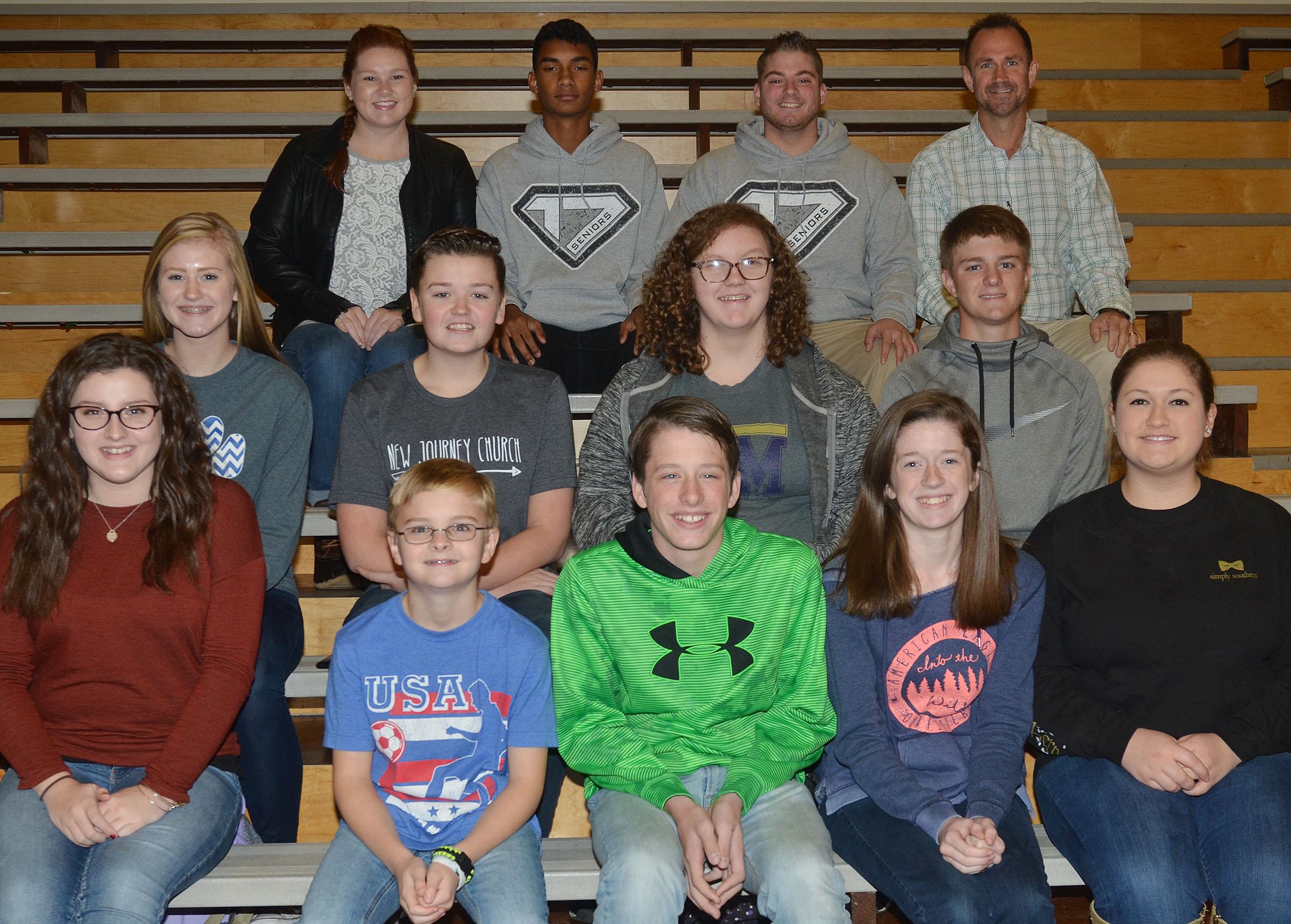 This year's CHS swim team includes, from left, front, freshman Alli Wilson, fifth-grader Caleb Holt, seventh-grader Seth Hash and freshman Gracyne Hash and Aleah Knifley. Second row, freshmen Isabella Osborne, Gavin Johnson and Emily Rodgers and junior Alex Doss. Back, seniors Mallory Haley, Daniel Silva and Jon Tanner Coppage and coach Steve Doss. Absent from the photo are sophomore Brandon Greer, junior Bryce Richardson, freshman Bailey Smith and fifth-grader Dalton Morris.