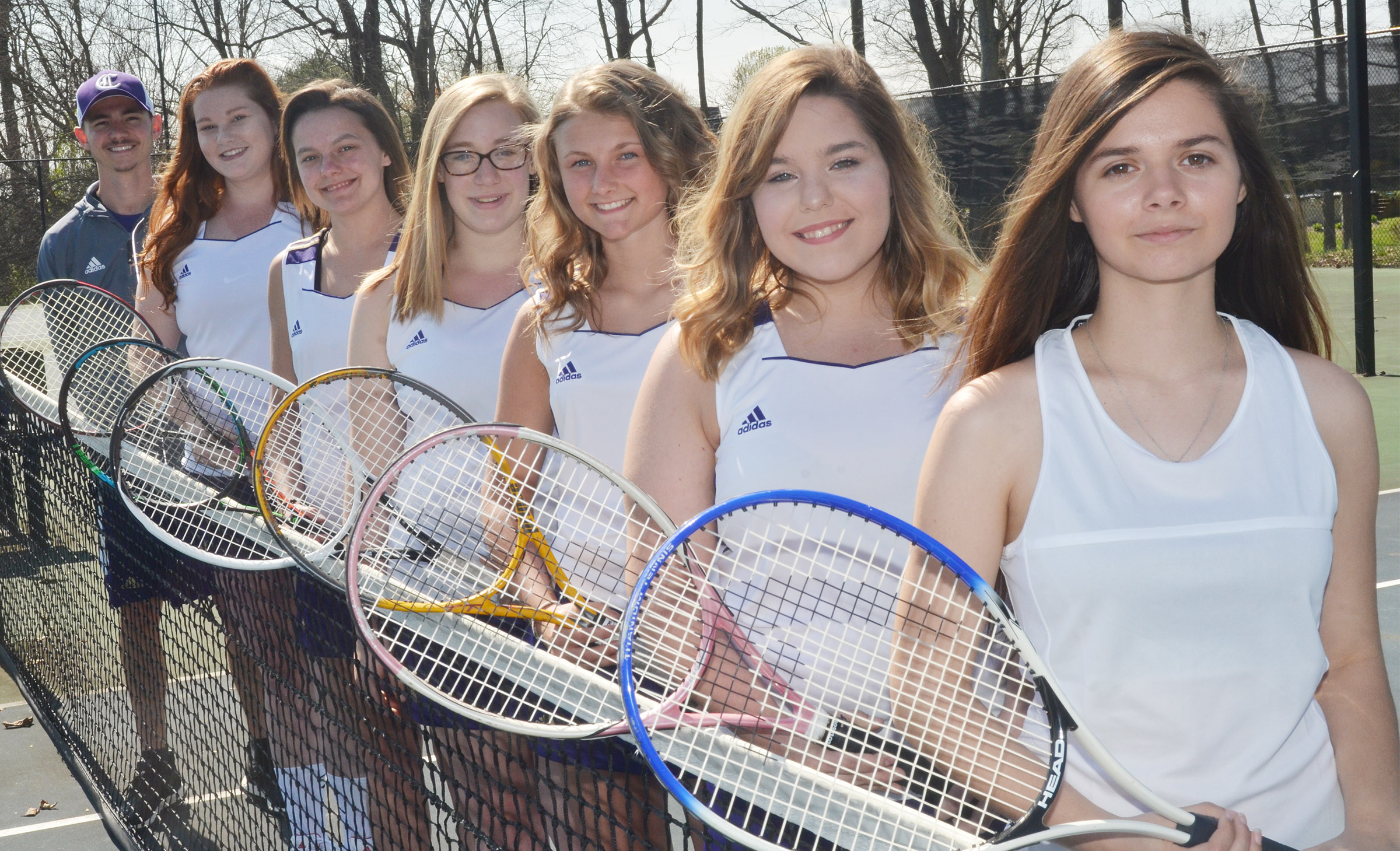 This year's CHS girls' tennis team includes, from left, coach Bradley Harris, seniors Mallory Haley and Kyrsten Hill, freshmen Samantha Johnson and Victoria Cox, junior Sara Farmer and senior Shauna Jones.