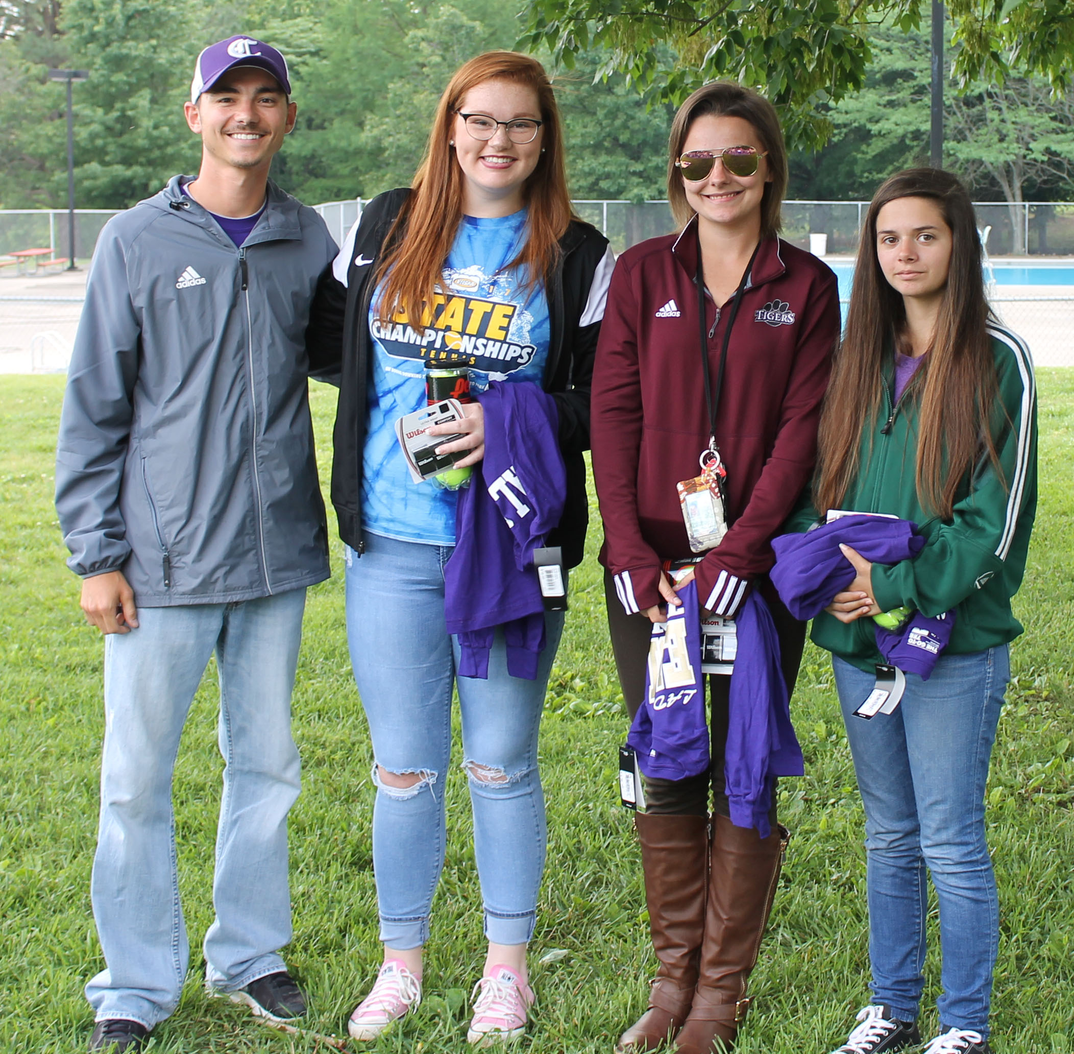 CHS girls' tennis coach Bradley Harris honors senior players, from left, Mallory Haley, Kyrsten Hill and Shauna Jones. CHS boys' senior player Zack Settle was unable to attend the banquet.