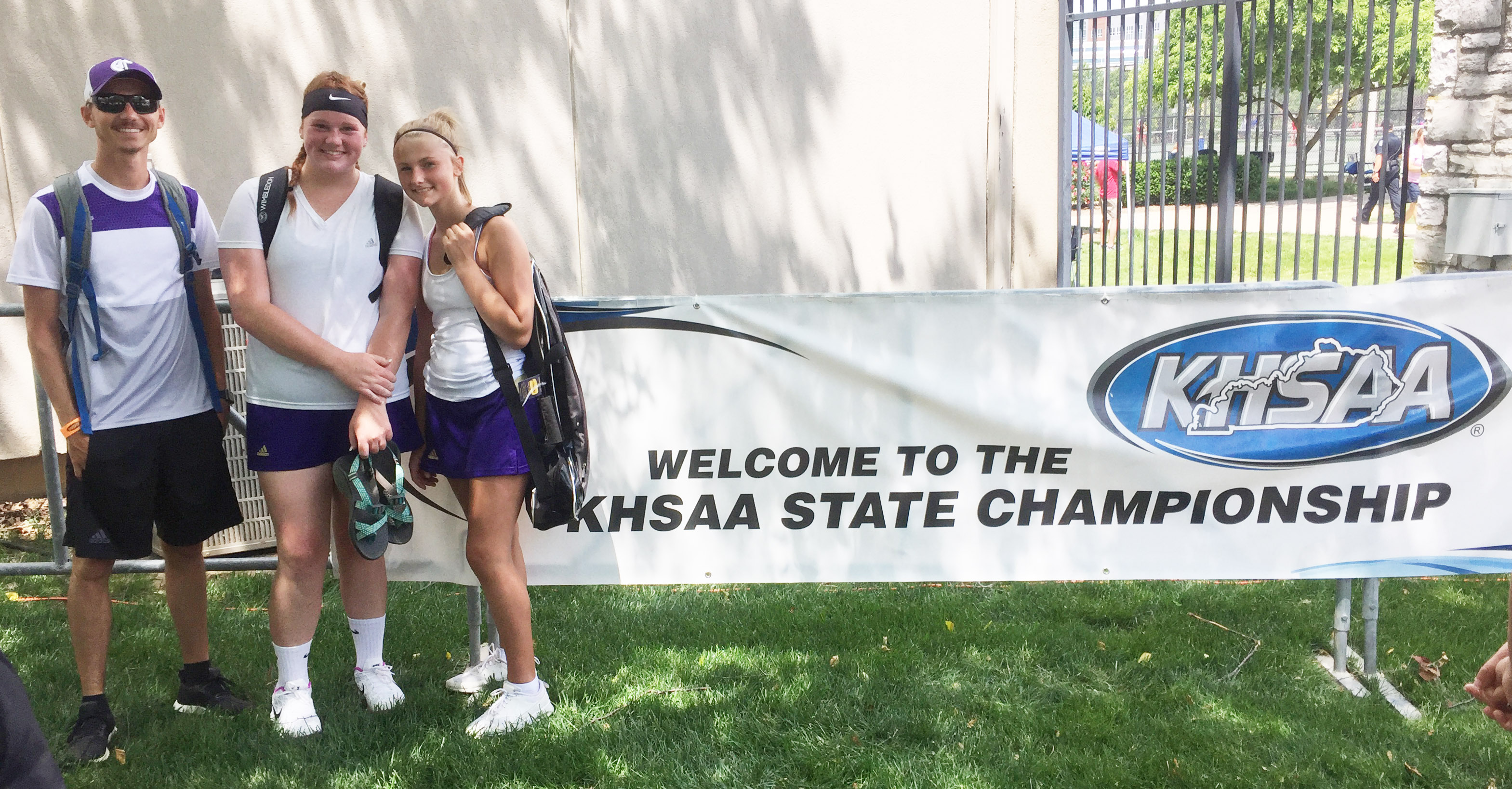 CHS tennis duo Mallory Haley, center, and freshman Victoria Cox played in the KHSAA state tennis tournament last week. At left is coach Bradley Harris.