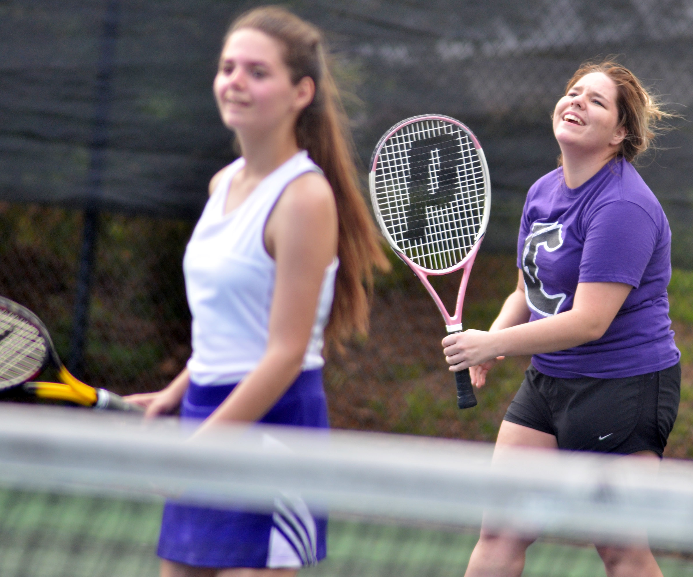 CHS junior Sara Farmer shares a laugh with doubles partner Shauna Jones, a senior.