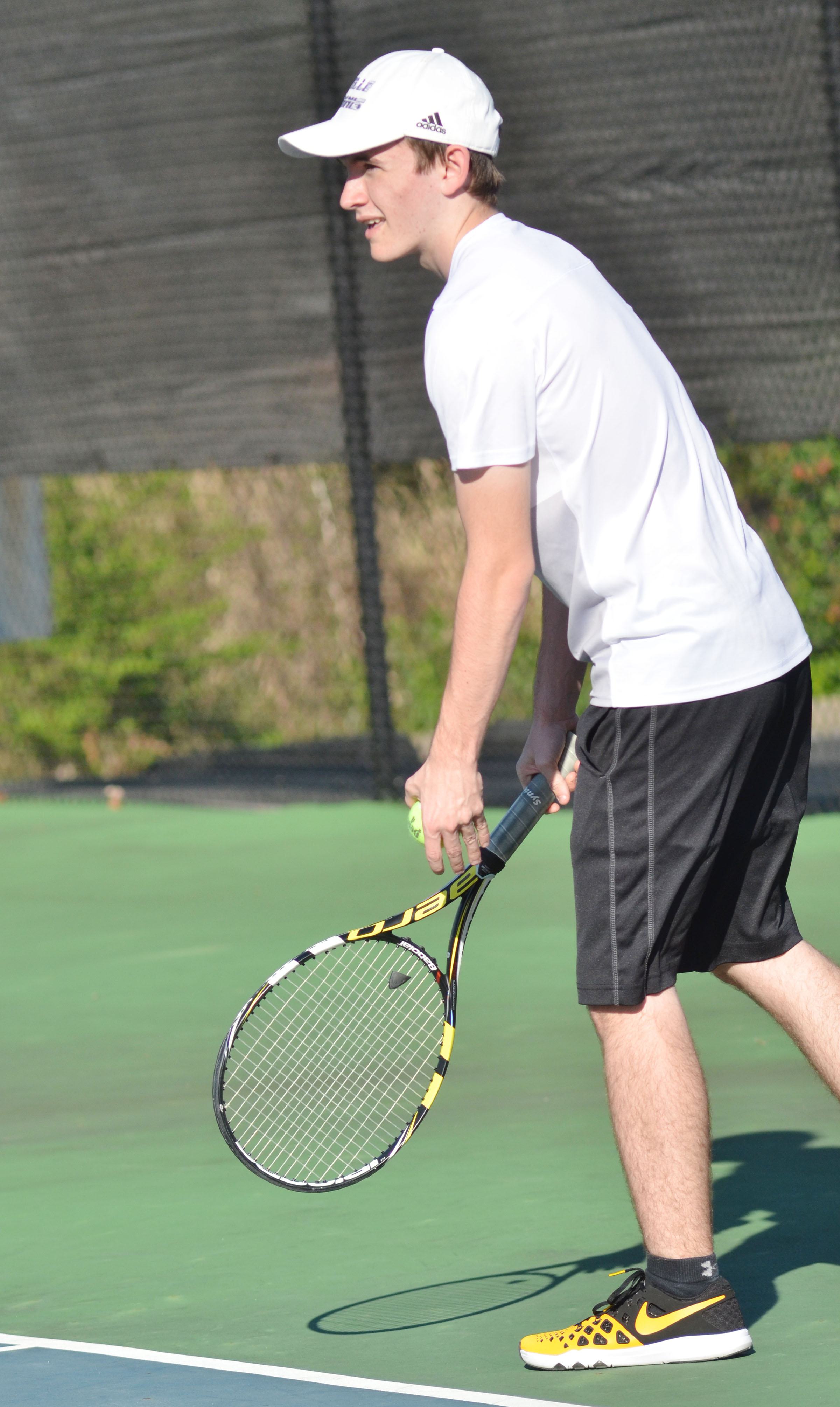 CHS junior Jackson Hunt serves.