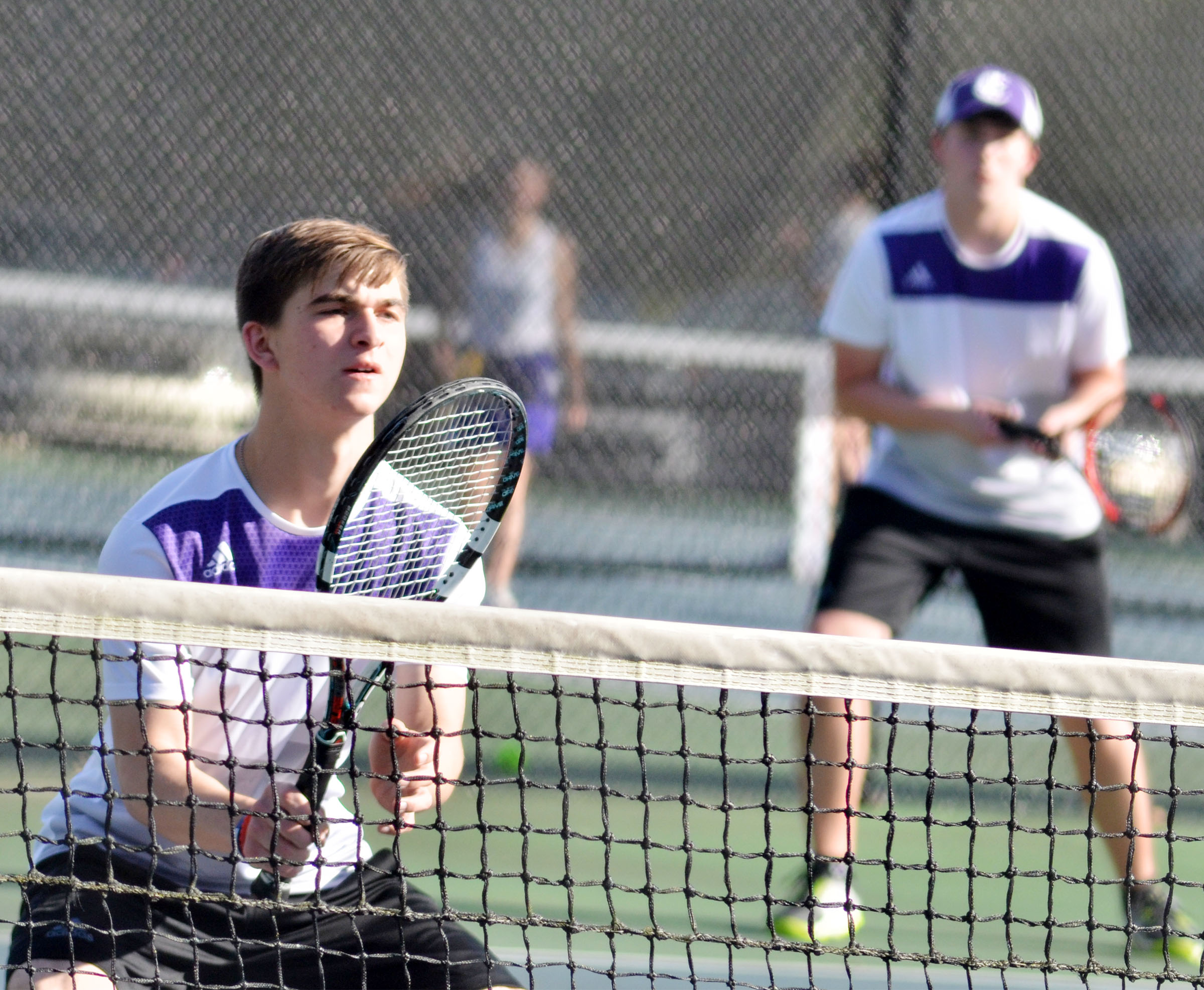 CHS junior Cass Kidwell guards the net as doubles partner Zack Settle, a senior, looks on.
