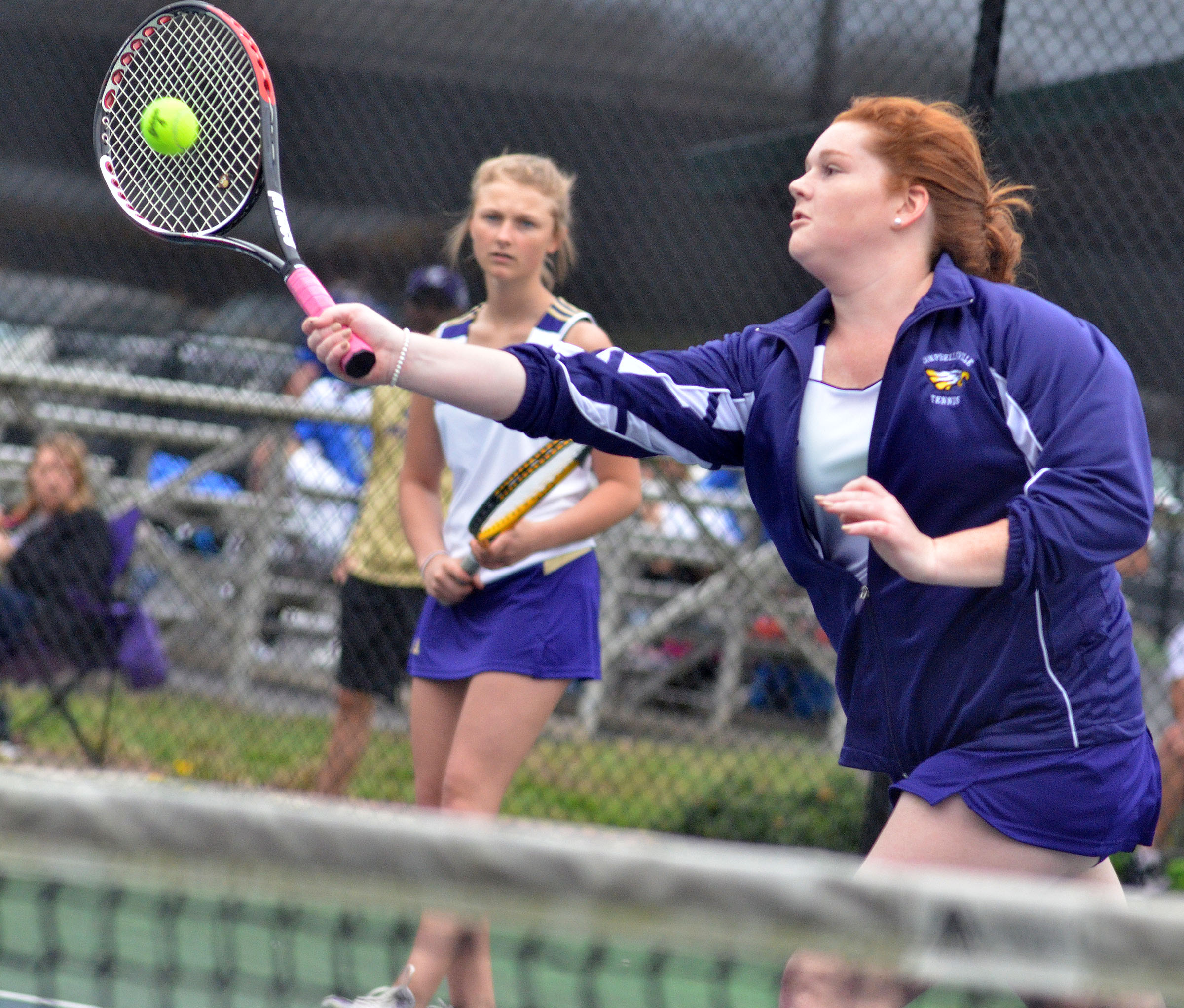 CHS senior Mallory Haley hits the ball in her doubles match with freshman Victoria Cox.