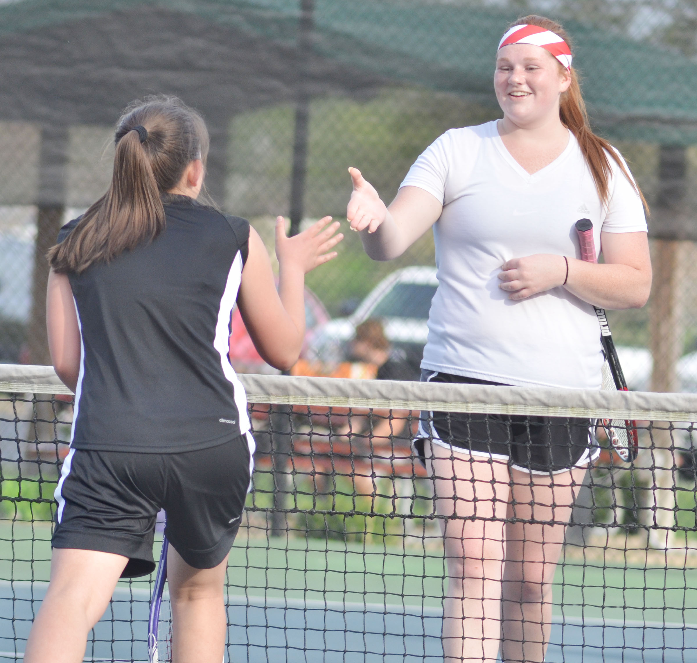 CHS senior Mallory Haley shakes hands with her opponent.