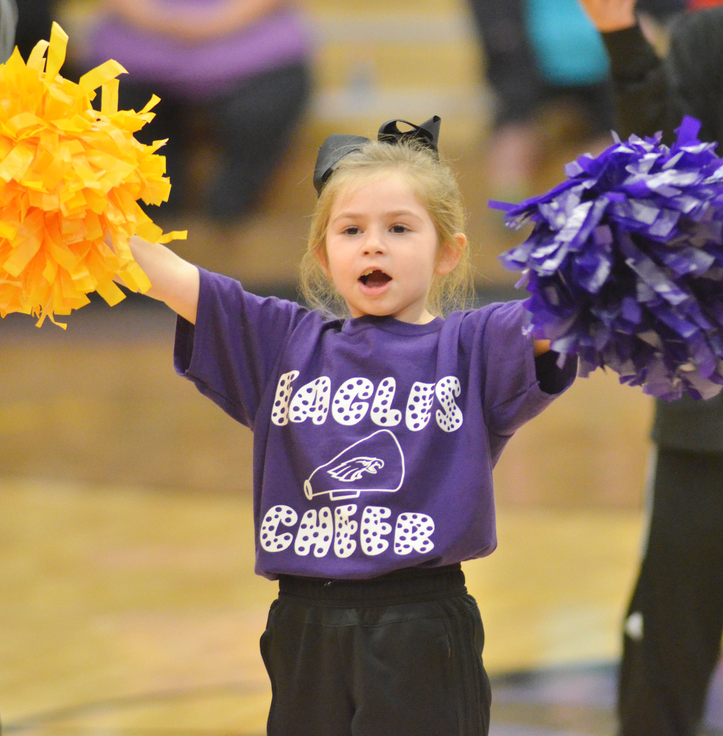 Campbellsville Elementary School first-grader Lainey Price cheers for the Eagles.