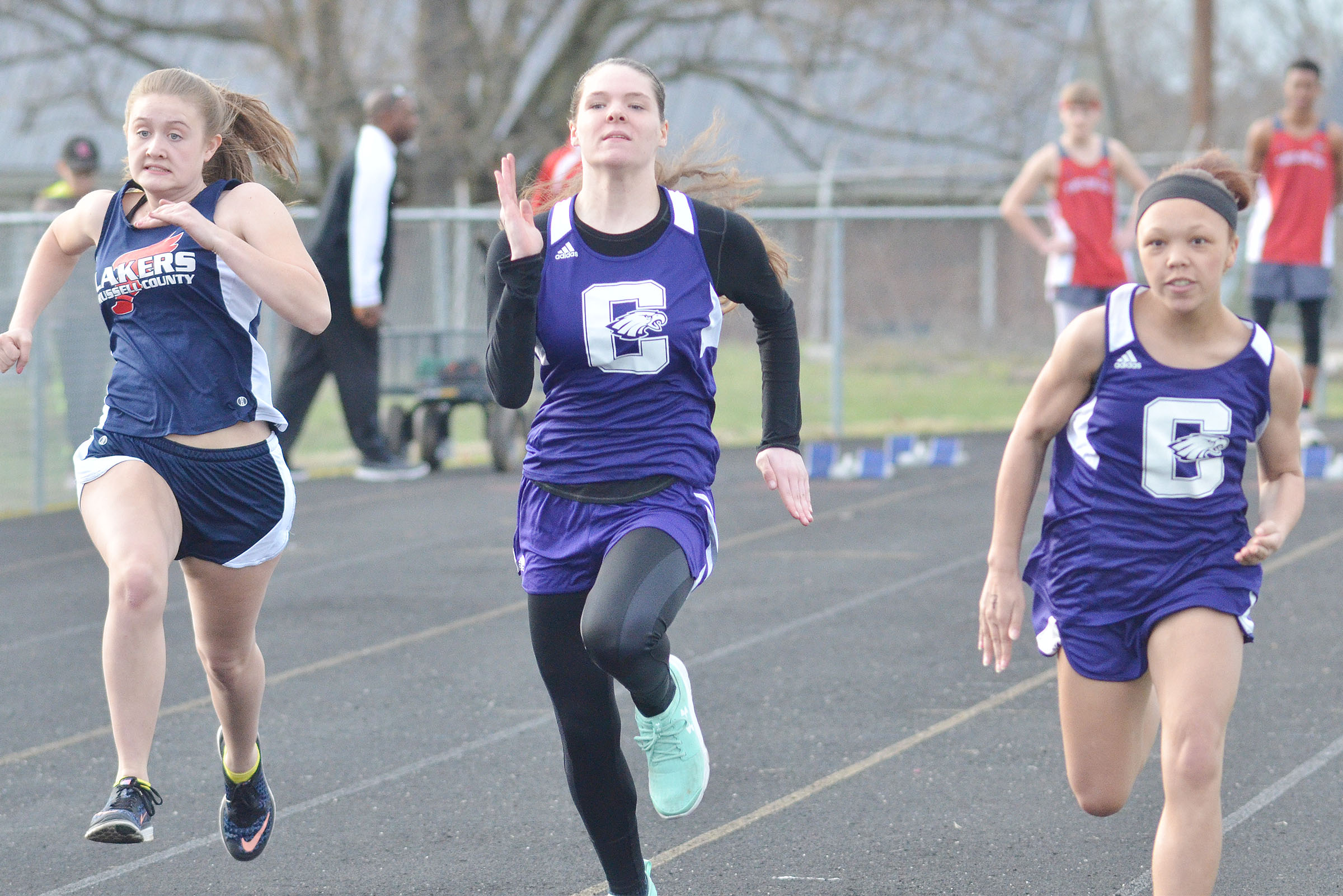 CHS sophomore Cassi Pipes, center, and CMS seventh-grader Kitana Taylor run.