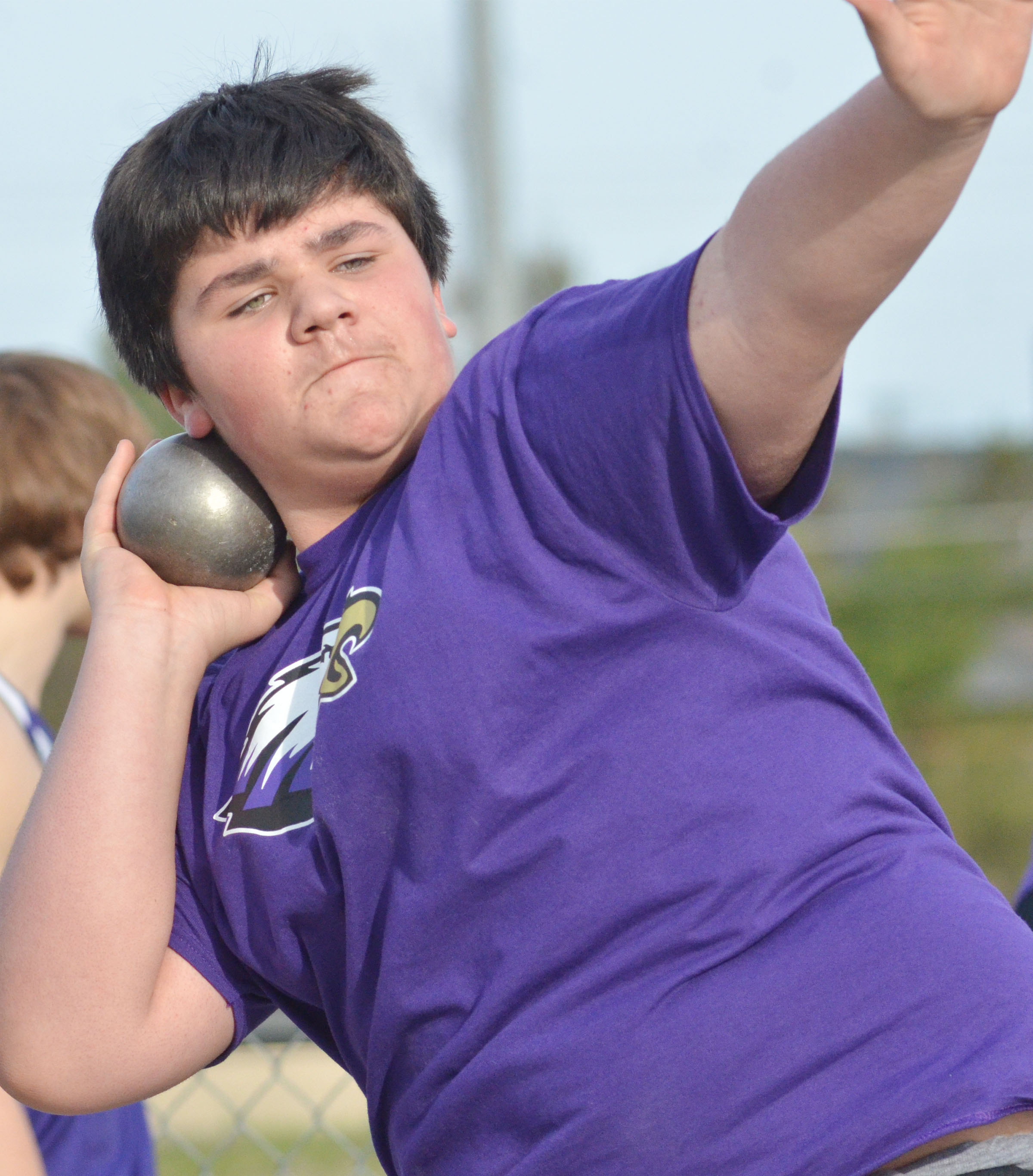 CMS seventh-grader Logan Rakes throws shot put.